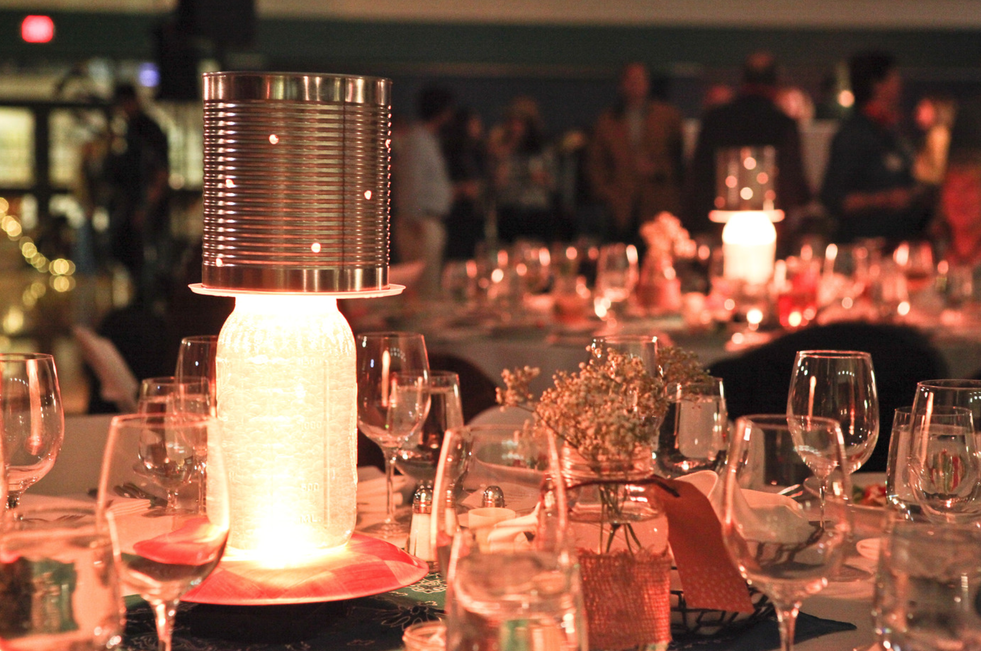 These centerpieces were created to match the Old West theme of the event, and are made with mason jars and used cans.  They are programmed to flicker like candles and give the dining room a warm glow.