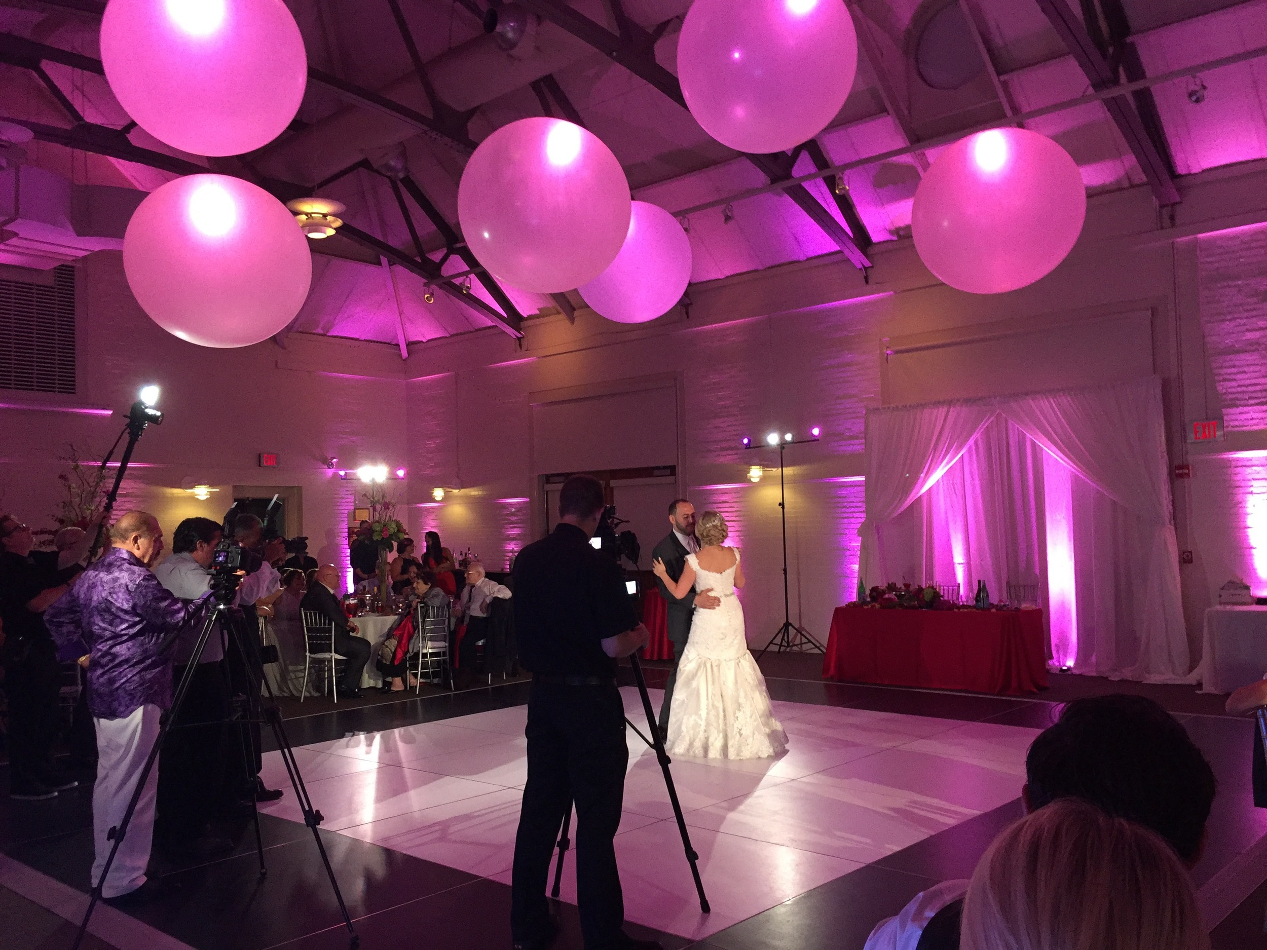 When Tatyana and Vadim took to the floor for their first dance, the room was transformed into a swirling dance of pink and white, and specially positioned spotlights rose on the dance floor, making them the stars of the show.