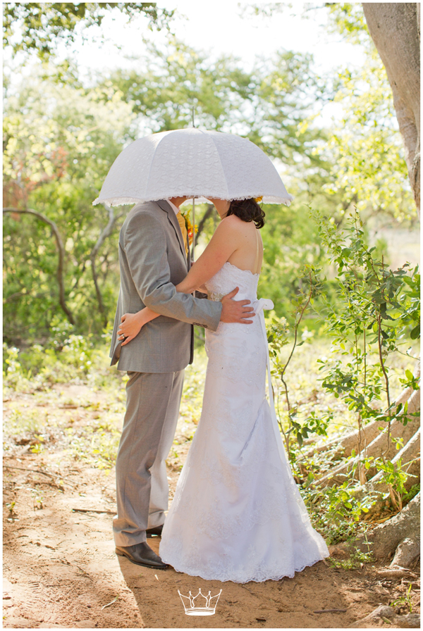 I adore this pic. The Umbrella was giving them some privacy during their photo session, and I all that came out from underneath where giggles.