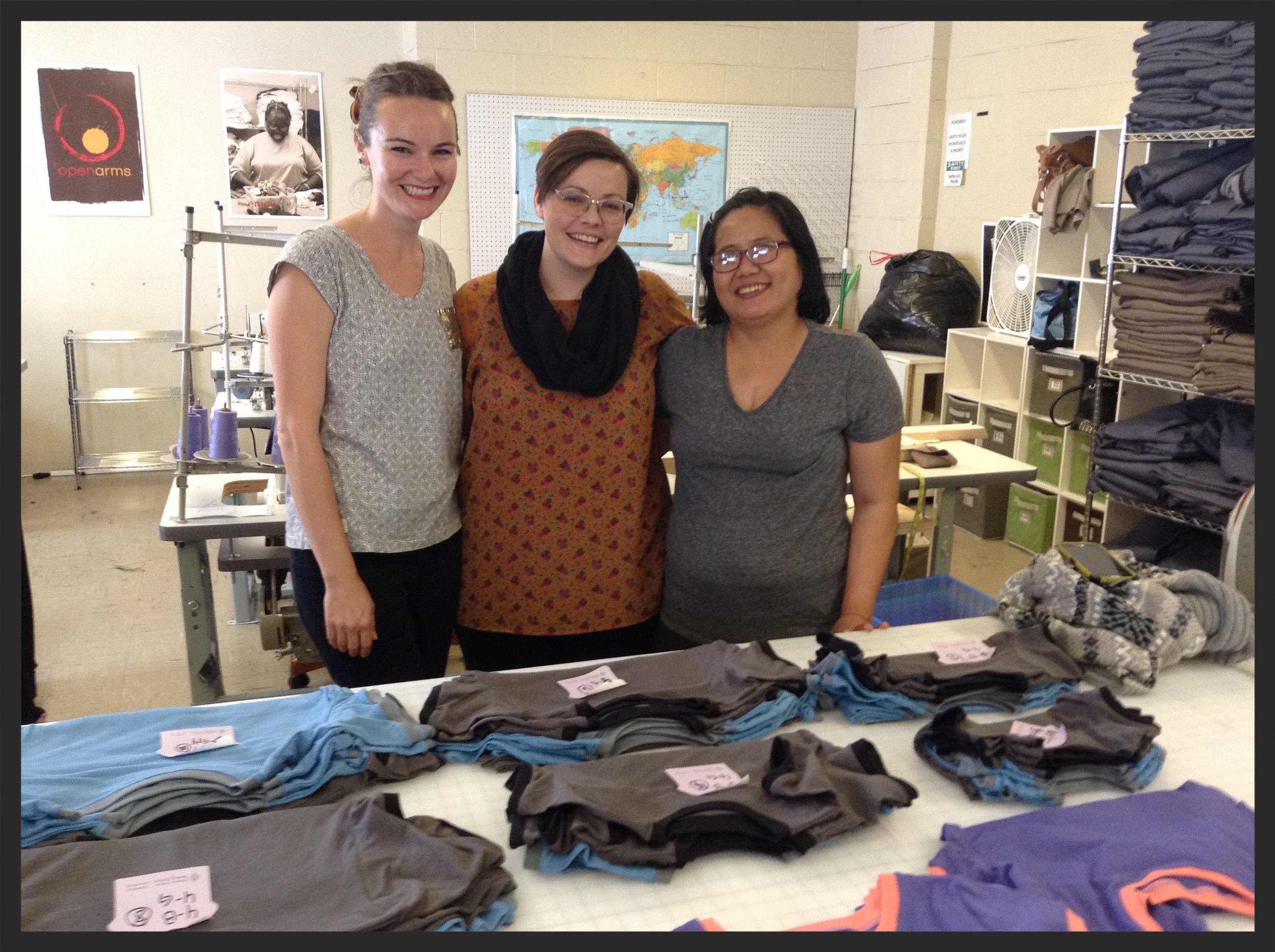 Evan, Emily, and Thang at Open Arms, reviewing the brand new Texas grown & sewn Tees!