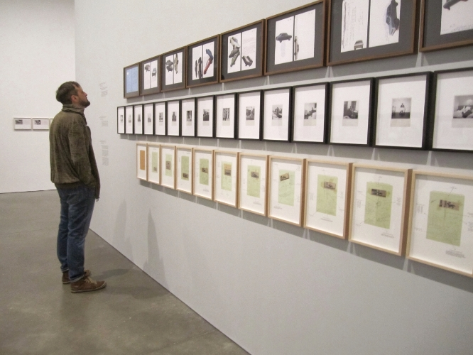 My husband checking out the Walid Raad exhibit