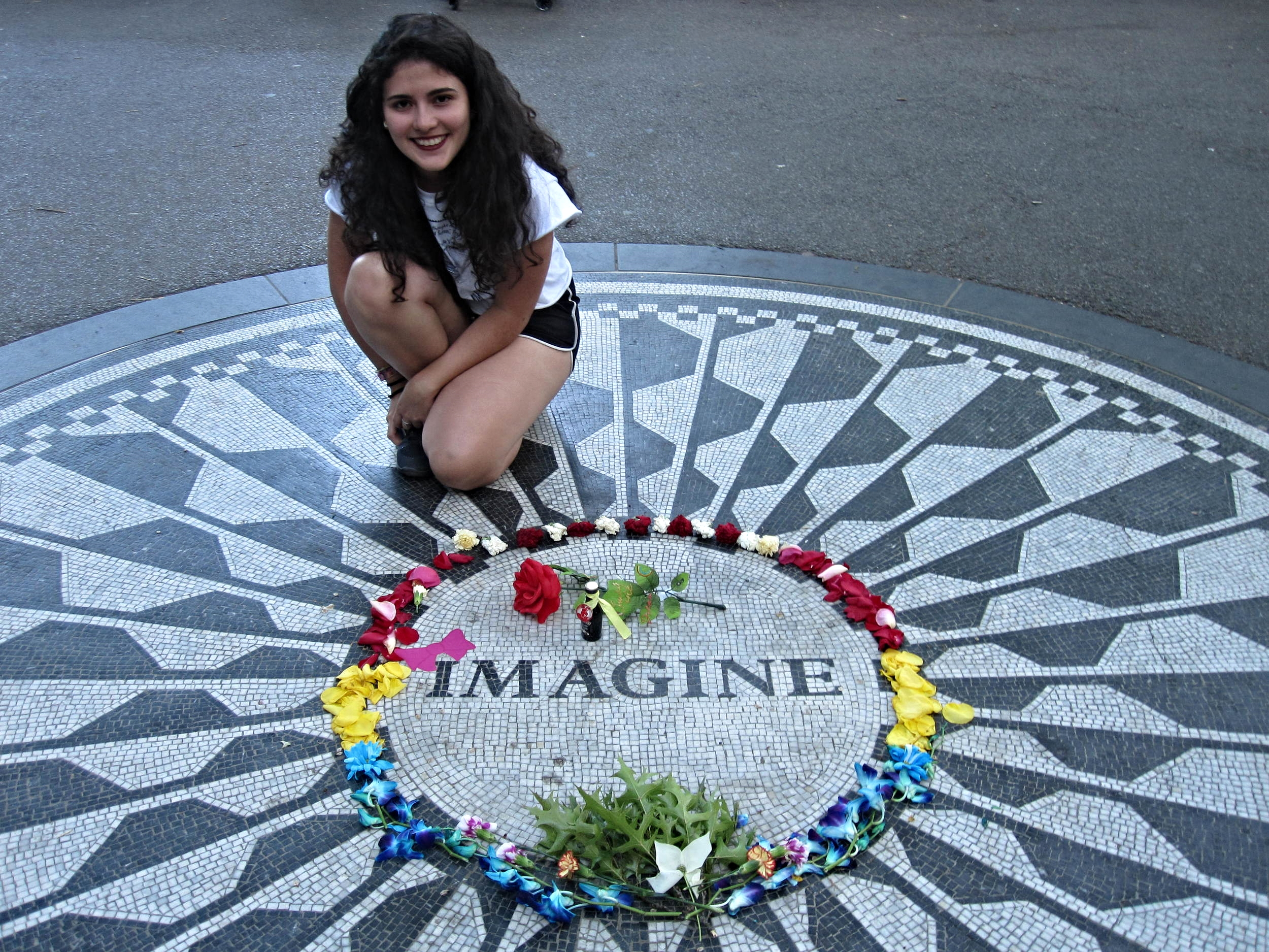 Andi posing for Pauline at the John Lennon Strawberry Fields Memorial in Central Park