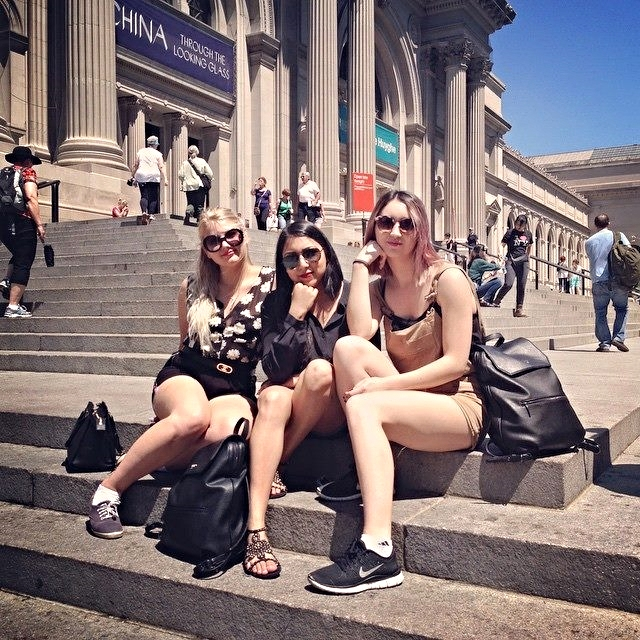 Olivia, Jessica, and Michelle on the steps of the Metropolitan Museum of Art.