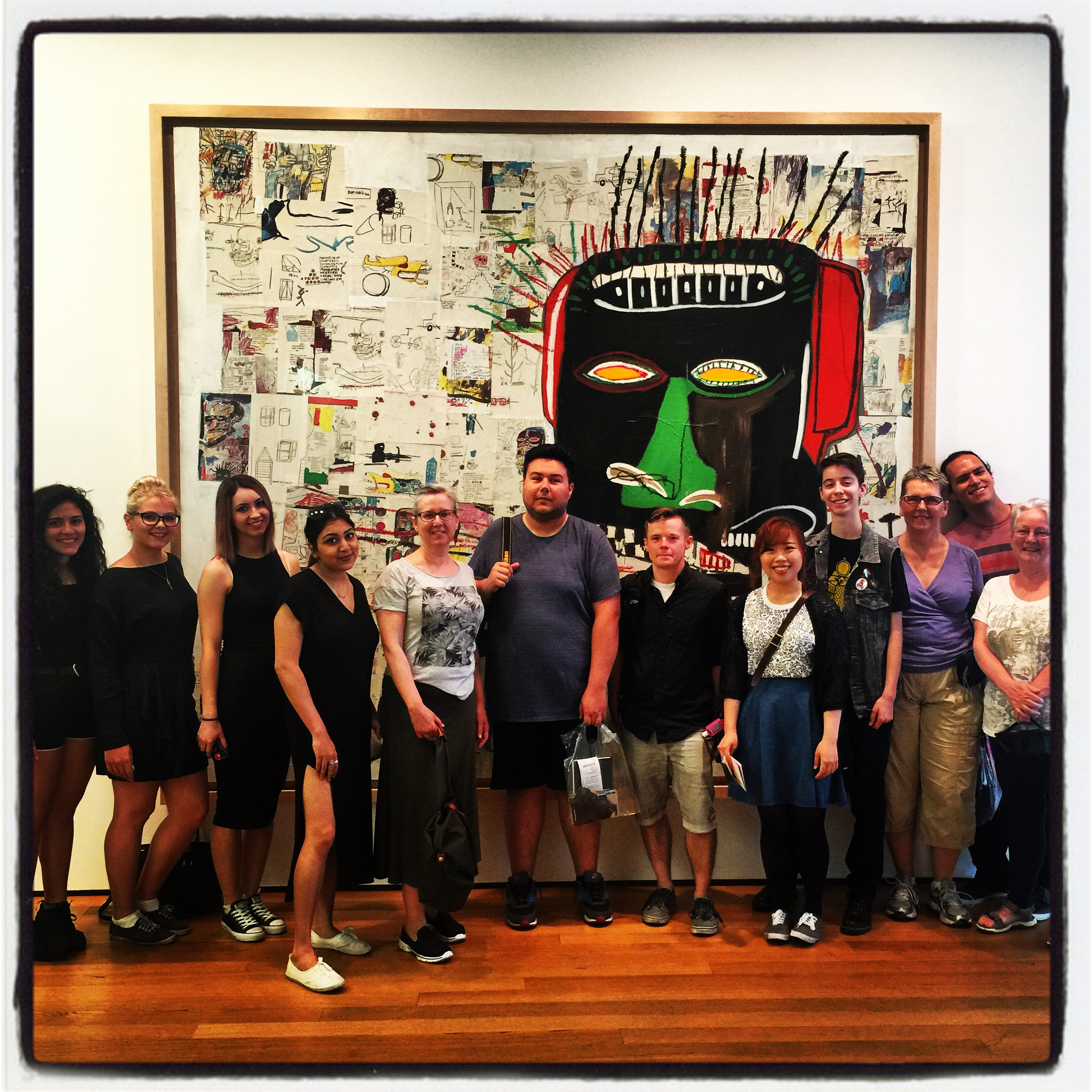 Posing with Basquiat at MoMA (James in the middle!).