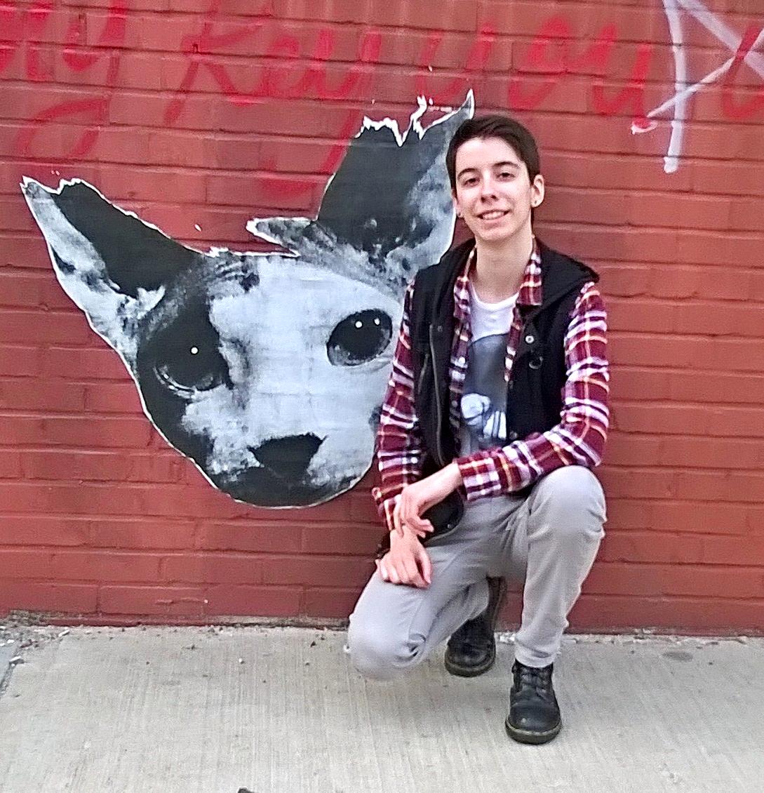 Jess posing in front of a stencilled street art work in Brooklyn-- her favourite neighbourhood in New York.