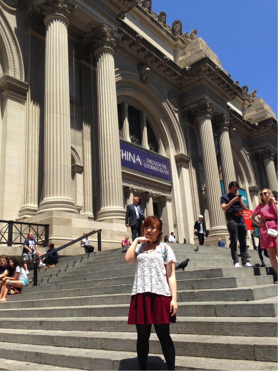 Cathrina posing on the steps of the Metropolitan Museum of Art.