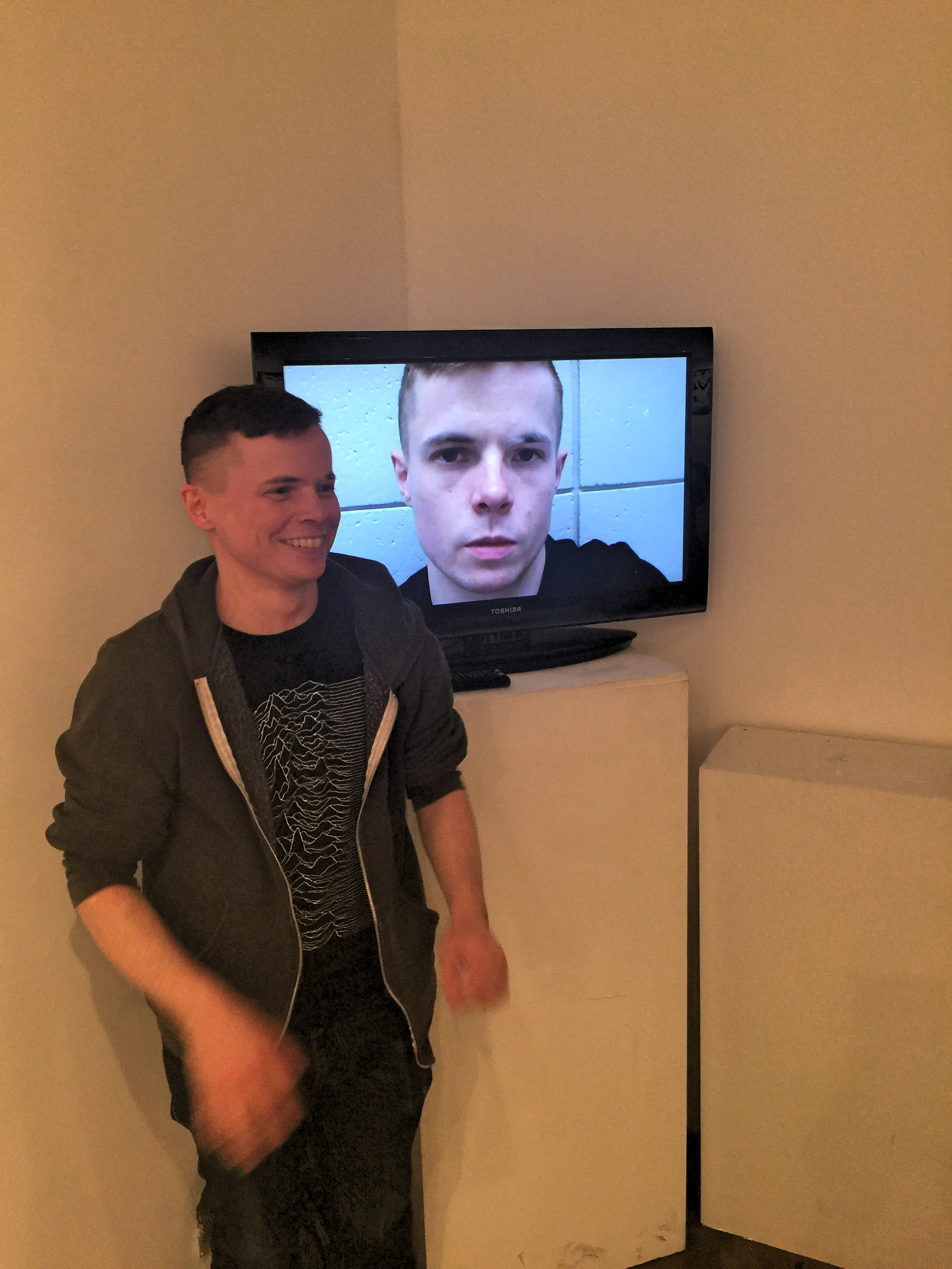 """Eric with his response piece to Acconci in the """"Talking Back"""" exhibition featured at KPU ahead of the trip to New York and Venice."""