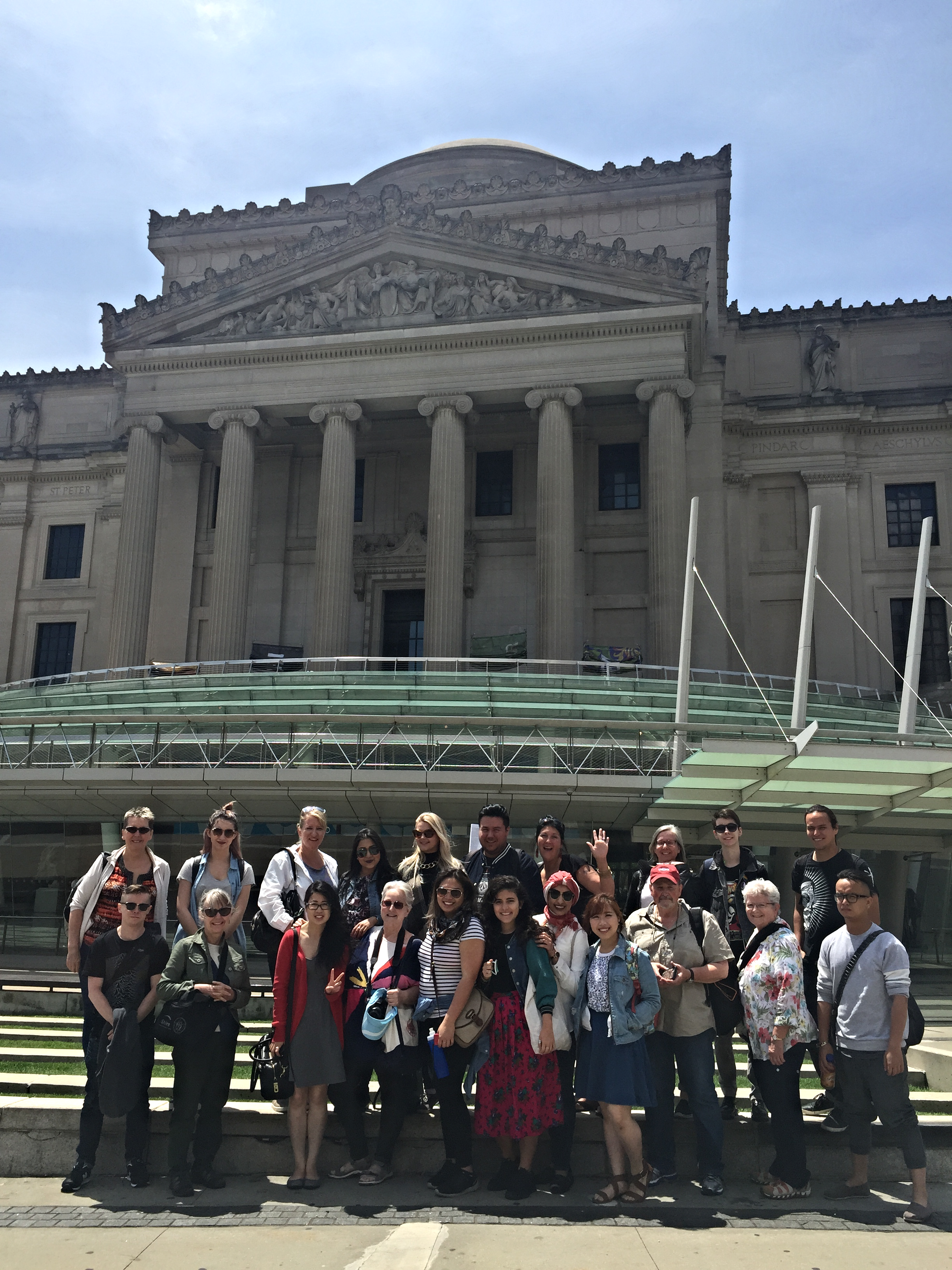 Group photograph in front of the majestic Brooklyn Museum. Merry is in the front row (fourth from the left) of the image.