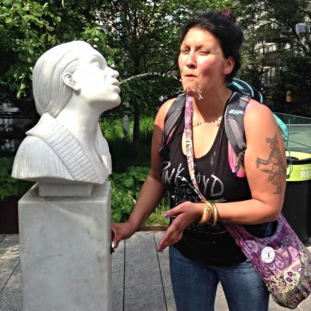 Roxanne enjoyed engaging with lots of the public art all over New York-- here she is with a sculpture immortalizing Bruce Nauman's   Self-Portrait as Fountain  , located on the ChelseaHighline.