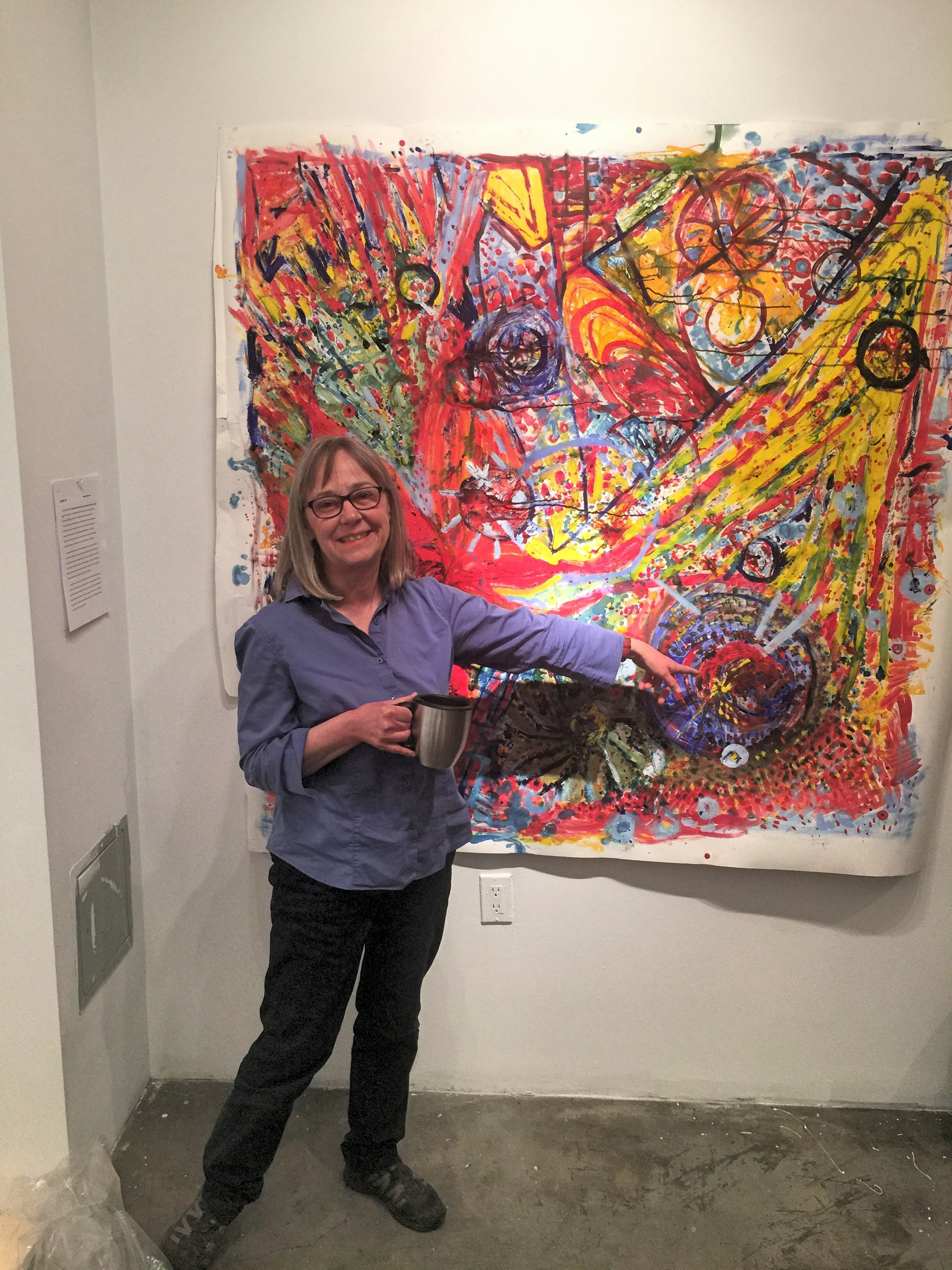 Here is Margaret standing in front of her painting at KPUthat is in conversation with her assignedartist Kerstin Bratsch.