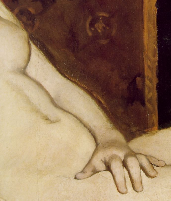 Detail of Olympia's hand at the central vertical axis of the painting