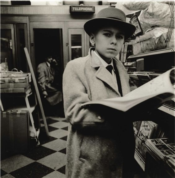 """Diane Arbus, Boy Reading A Magazine, N.Y.C. (1956). Arbus was one of several photographers featured at the """"Outsiders"""" exhibition I visited at the AGO in Toronto this past week."""