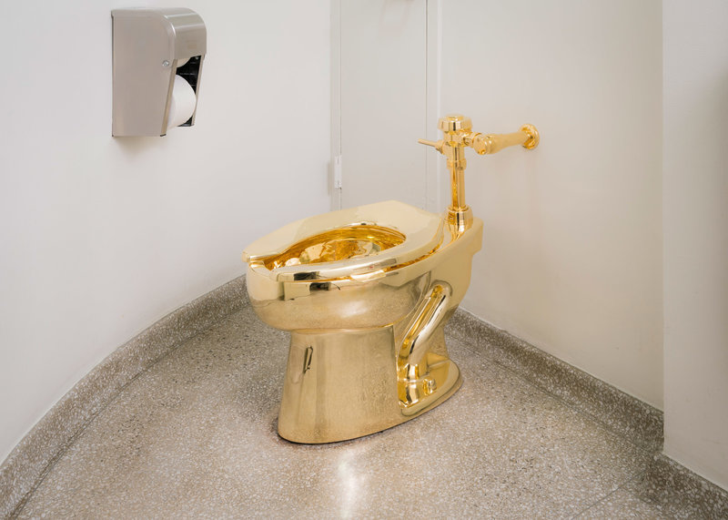 """Behold The Throne: There's A Golden Toilet At The Guggenheim"""