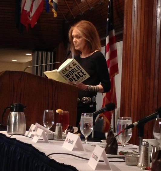 Gloria Steinem reading a passage from   Sex and World Peace .  Image courtesy of  Women's Media Center .