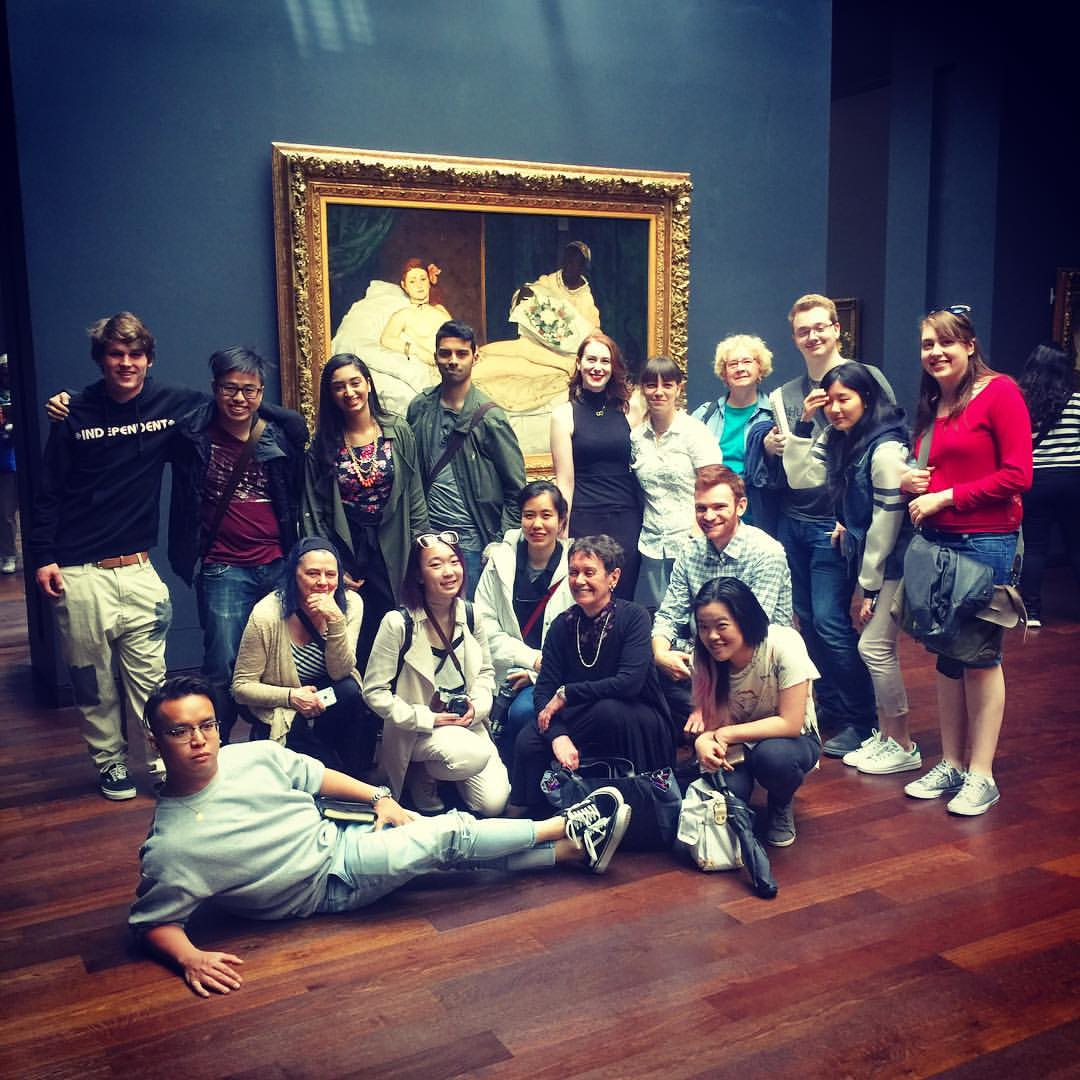 Alice (center) and field school students pose in front of Manet's iconic  Olympia  (1863) at the Orsay Museum.