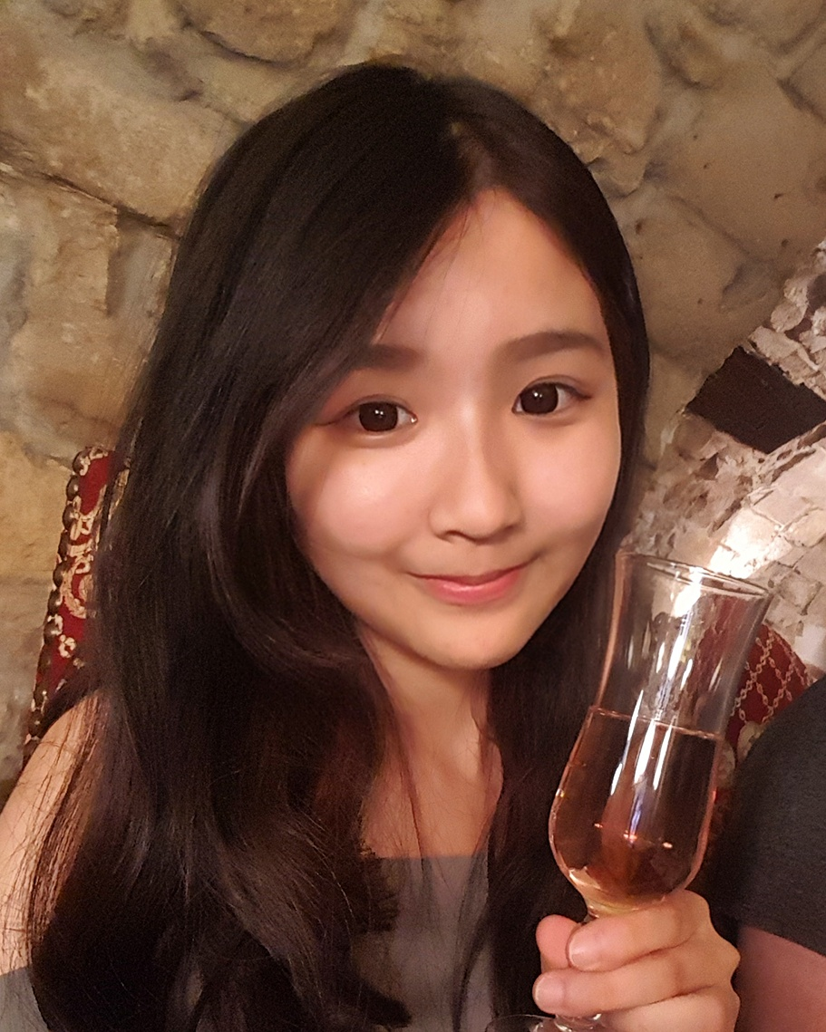 Tiffany enjoying a glass of French champagne at the Paris group dinner.