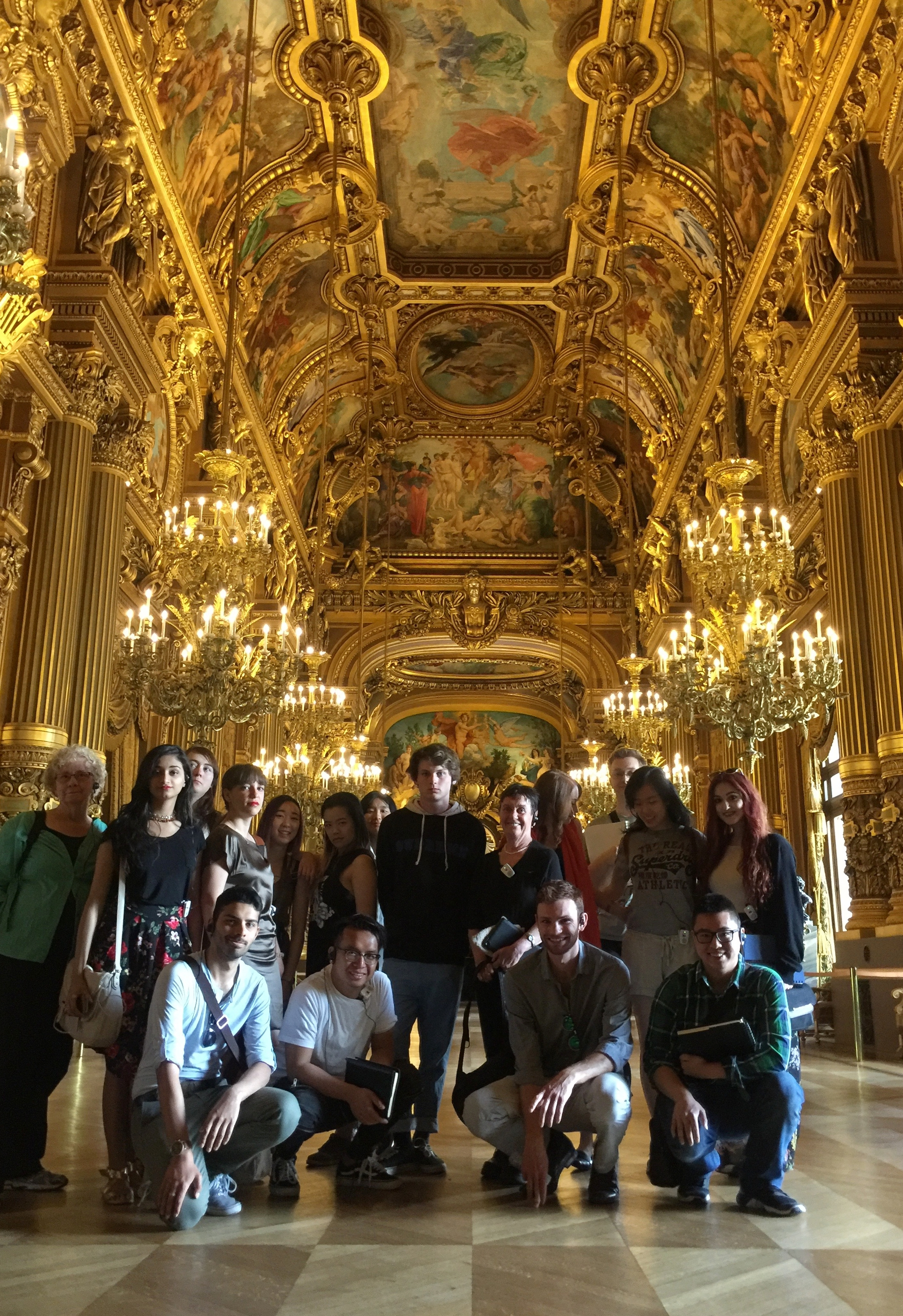 """Group photograph in the Opera's """"hall of mirrors""""-- Tiffany just off center peeking over Lukas's left shoulder."""