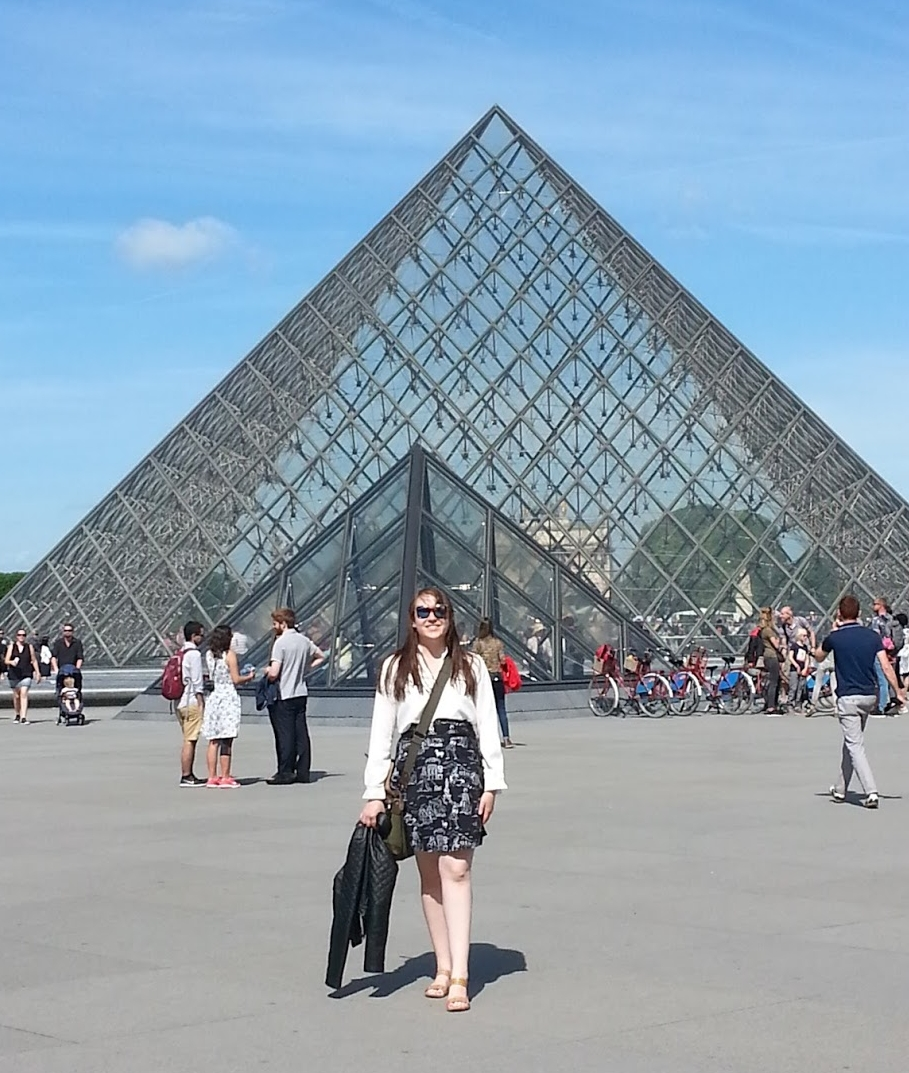 Josie posing in front of the iconic glass pyramid at the Louvres complex in Paris.