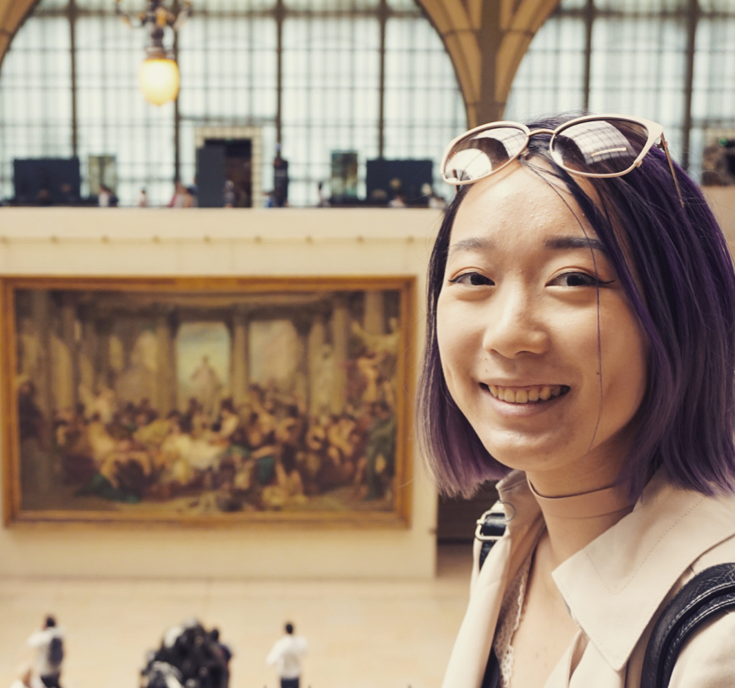 Meet Jenny, posing here in the grand hall of the Orsay Museum in Paris.