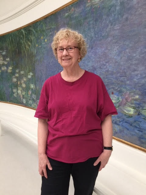 Meet Dorothy, a visual artist who first visited Documenta twenty years ago-- here she is posing in front of Monet's famous  Water Lillies  mural at the L'Orangerie gallery in Paris.