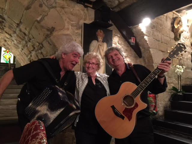 Dorothy having some fun with the entertainers at the Paris group dinner!