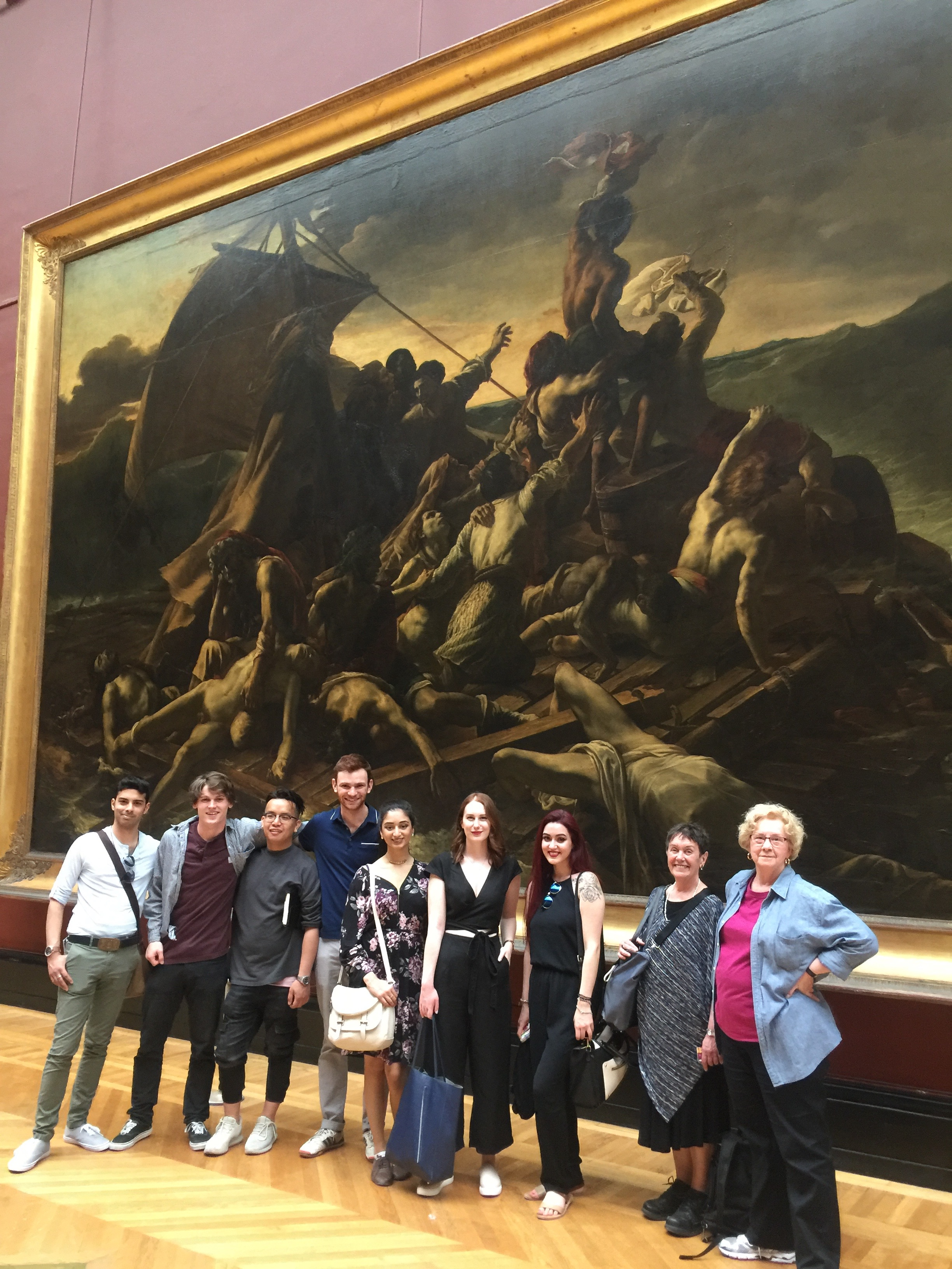 Back in Paris at the Louvre Museum, Stephane (at far left) poses with field school students in front of Gericault's  Raft of the Medusa  (1818-19).