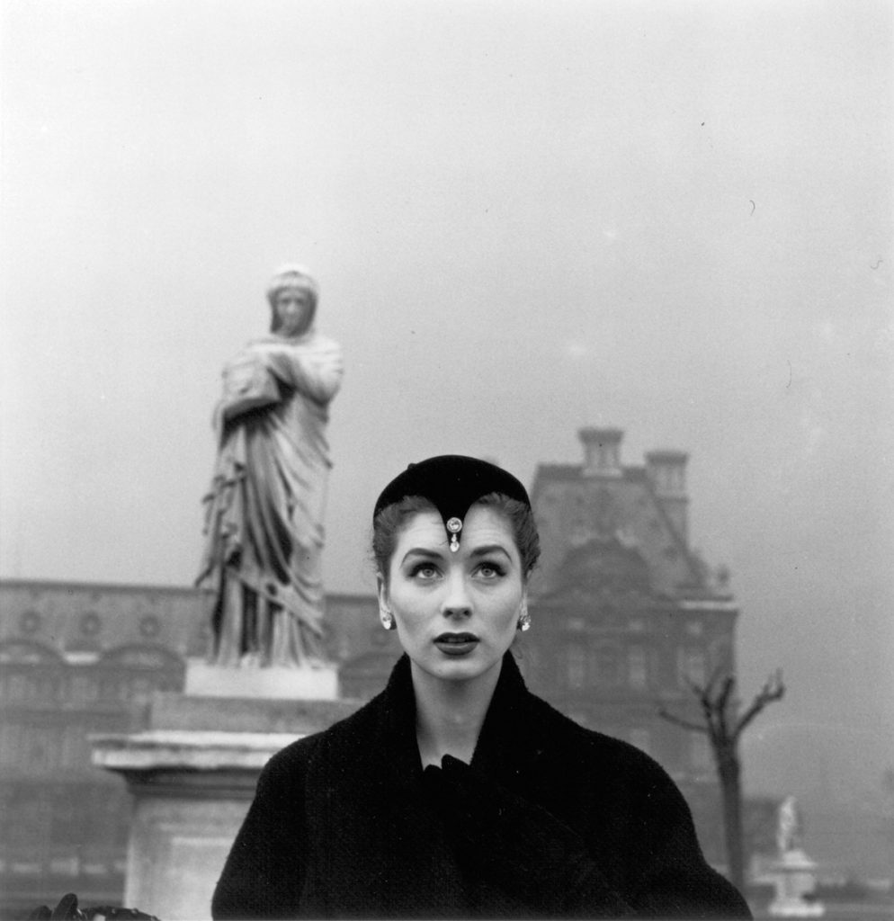 Louise Dahl-Wolfe, Suzy Parker in Dior Hat, Tuileries, Paris  (1950). Dahl-Wolfe, artist turned influential fashion photographer pioneer, was born on this day in 1895.