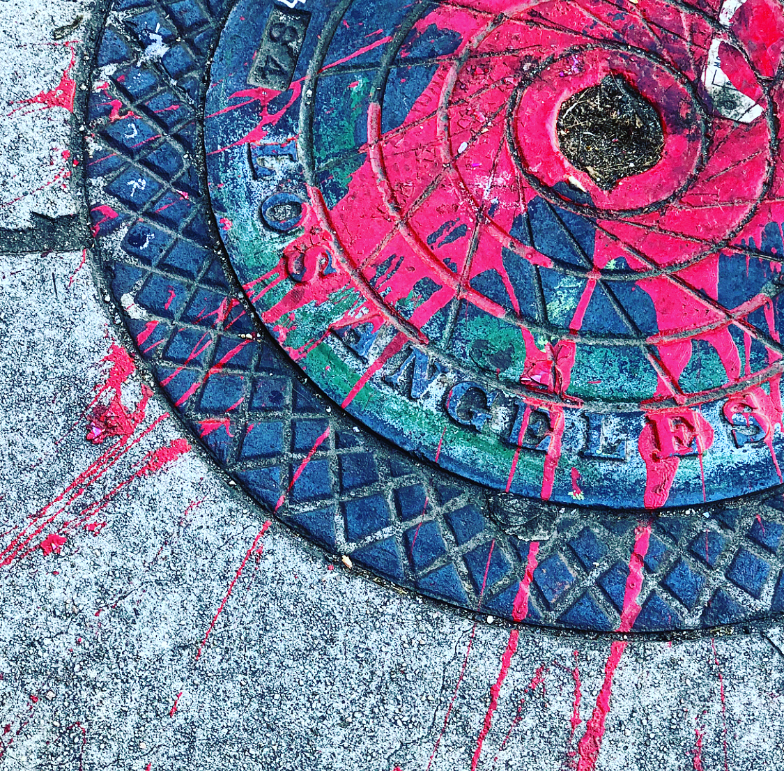 I took many photos like this of the painted sidewalks in the LA Arts District-- be sure to keep your eyes down as much as up when hunting for street art. Image:  @dbarenscott Instragram