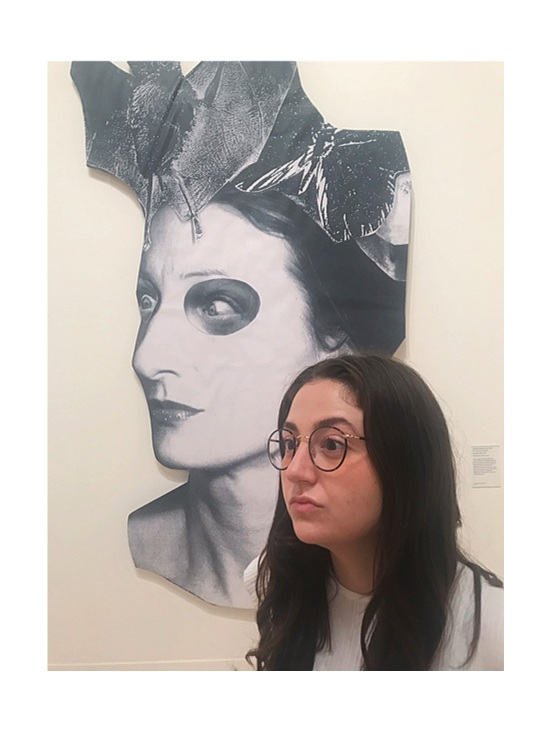 Meet Melanie, posing here at the Tate Britain with one of her assigned artworks, Monster Chetwyn's  Crazy Bat Lady  (2018)