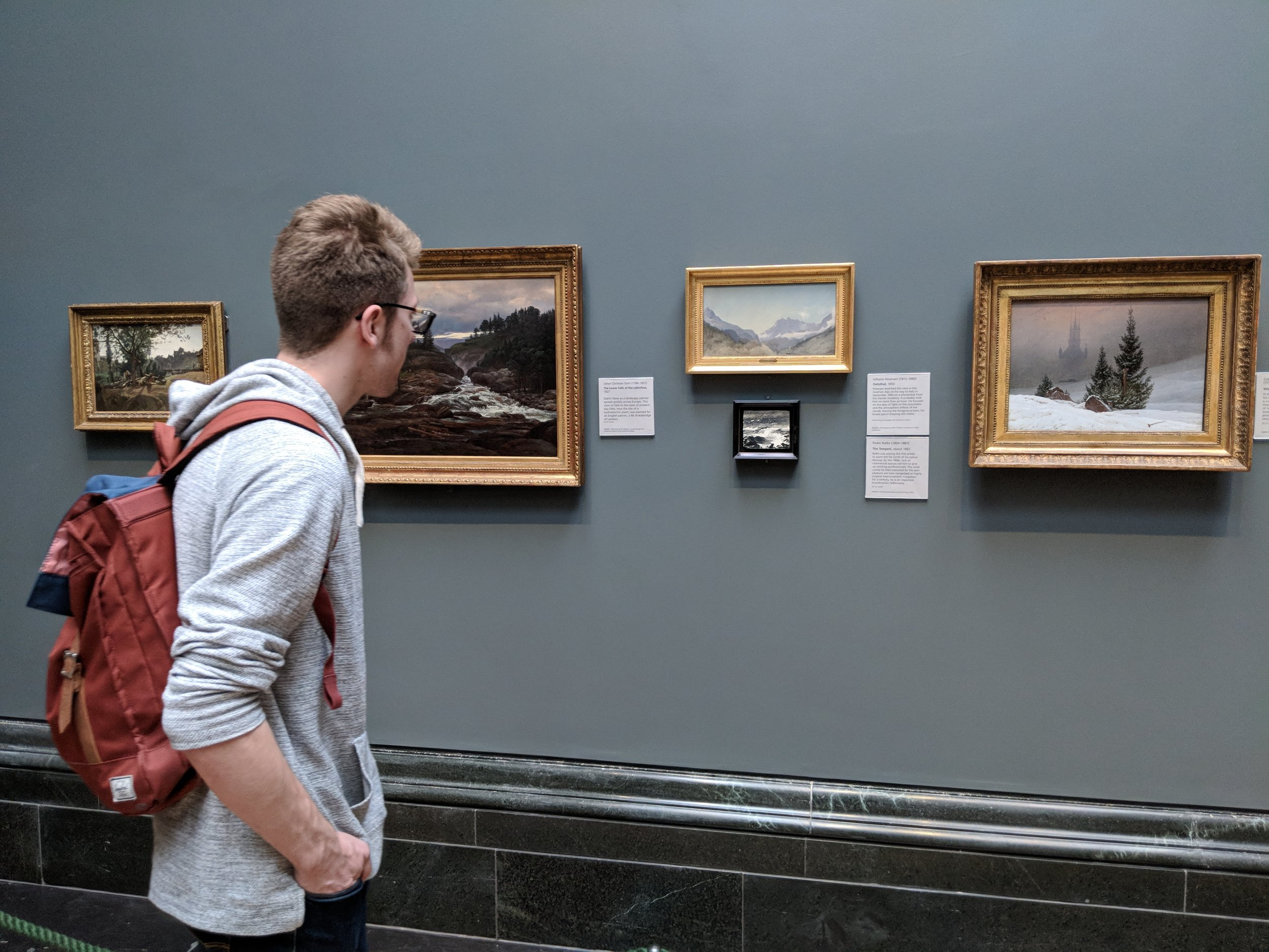 Meet field school blogger Reggie, looking here at landscape paintings at the National Gallery in London.