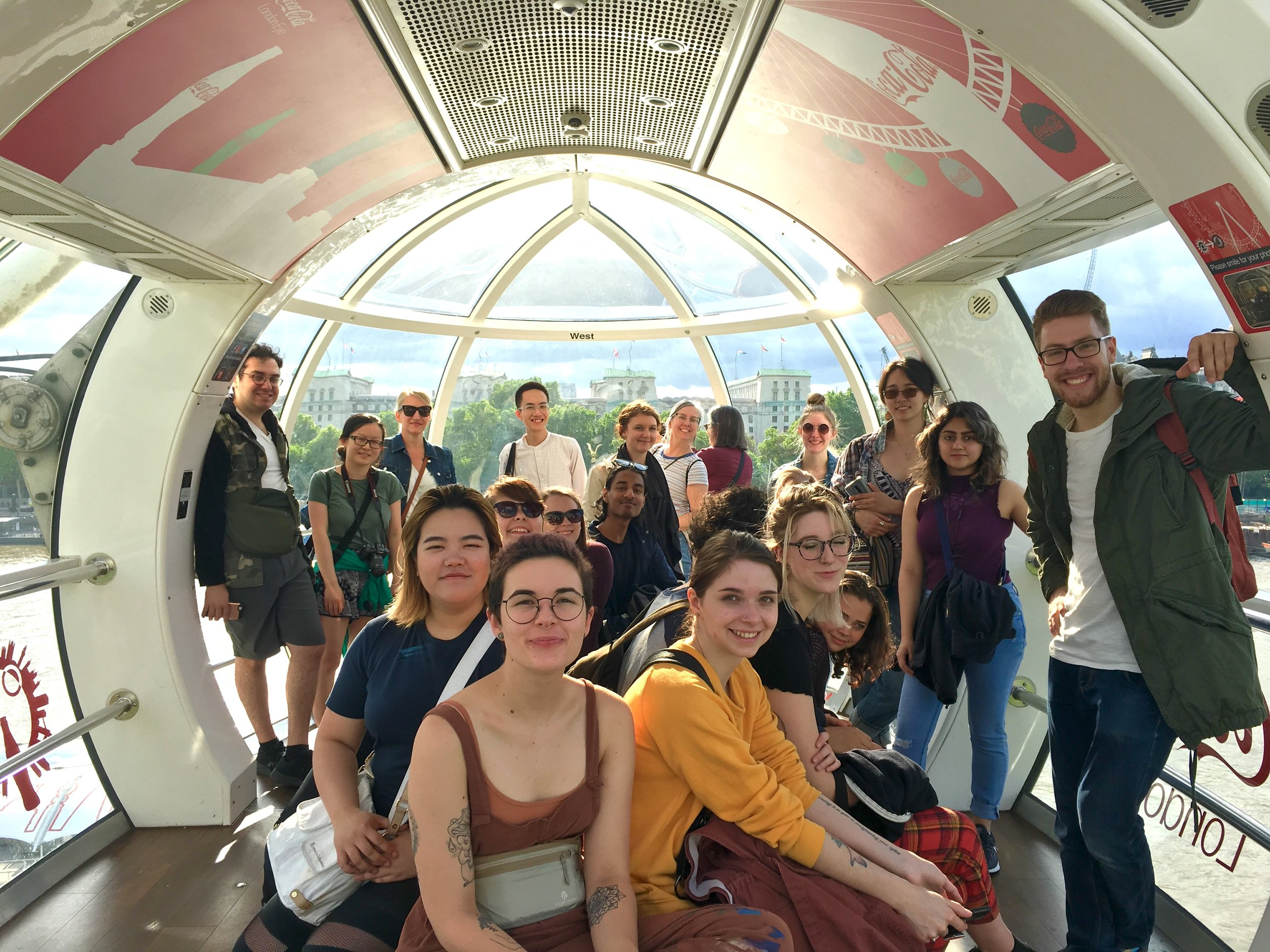 Up over the city on the London Eye— a great group shot with Reggie in the front far right hand corner of the image.