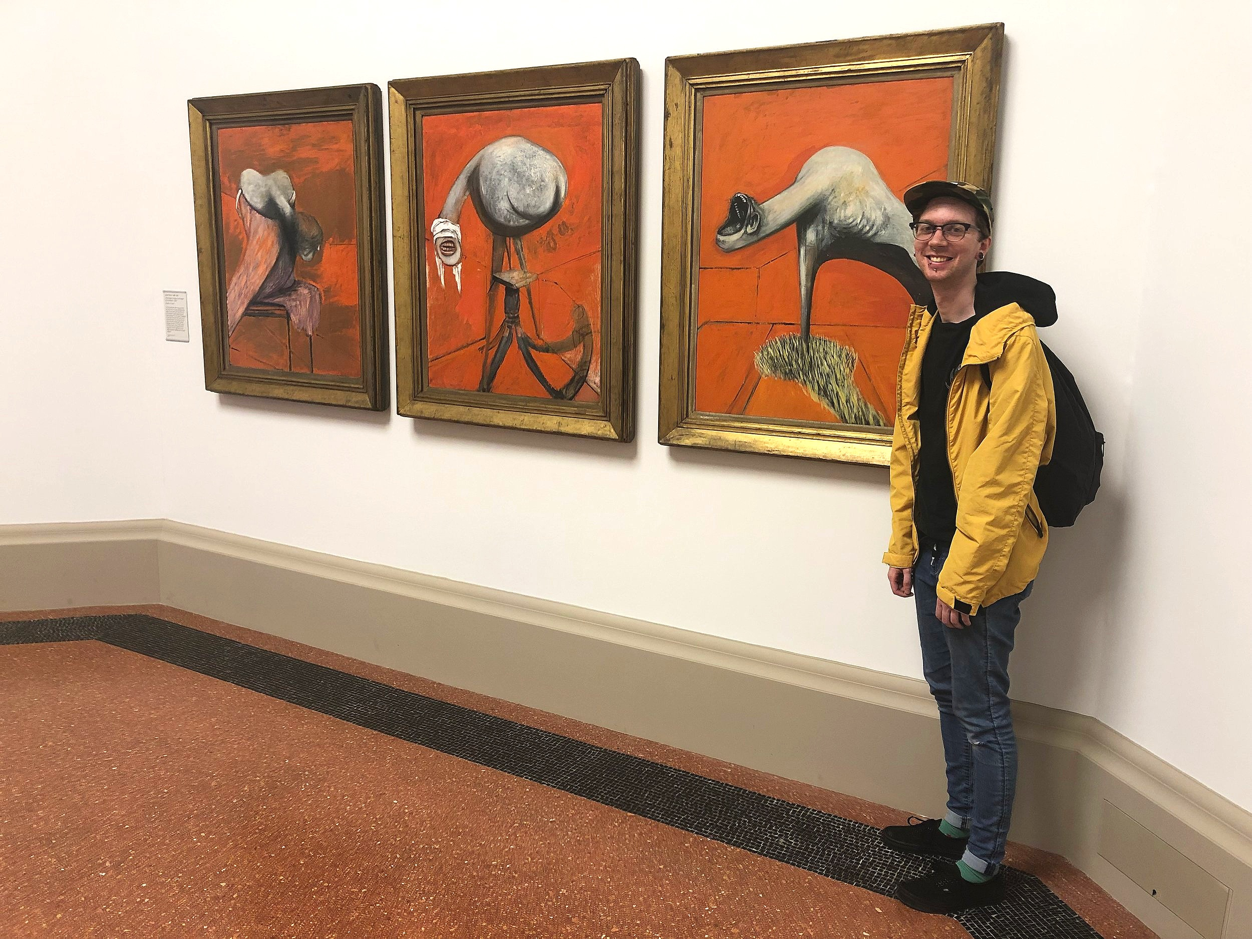 Meet field school blogger Mark posing with his assigned work from the Tate Britain, Francis Bacon's  Three Studies For Figures At A Base of A Crucifix  (1944)