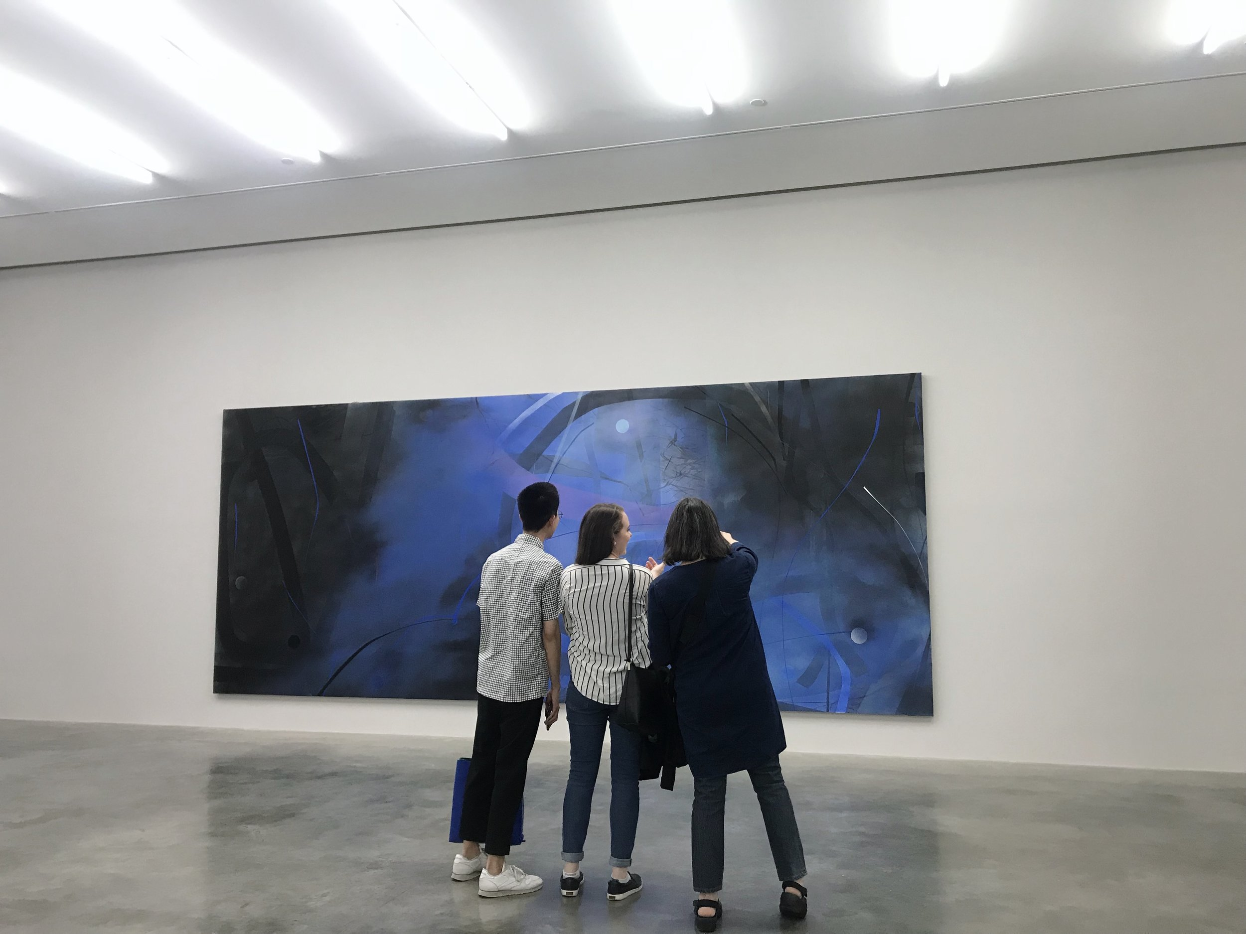 Ronald, Alison, and Elizabeth taking a closer look at a Zhou Li painting at the White Cube Gallery