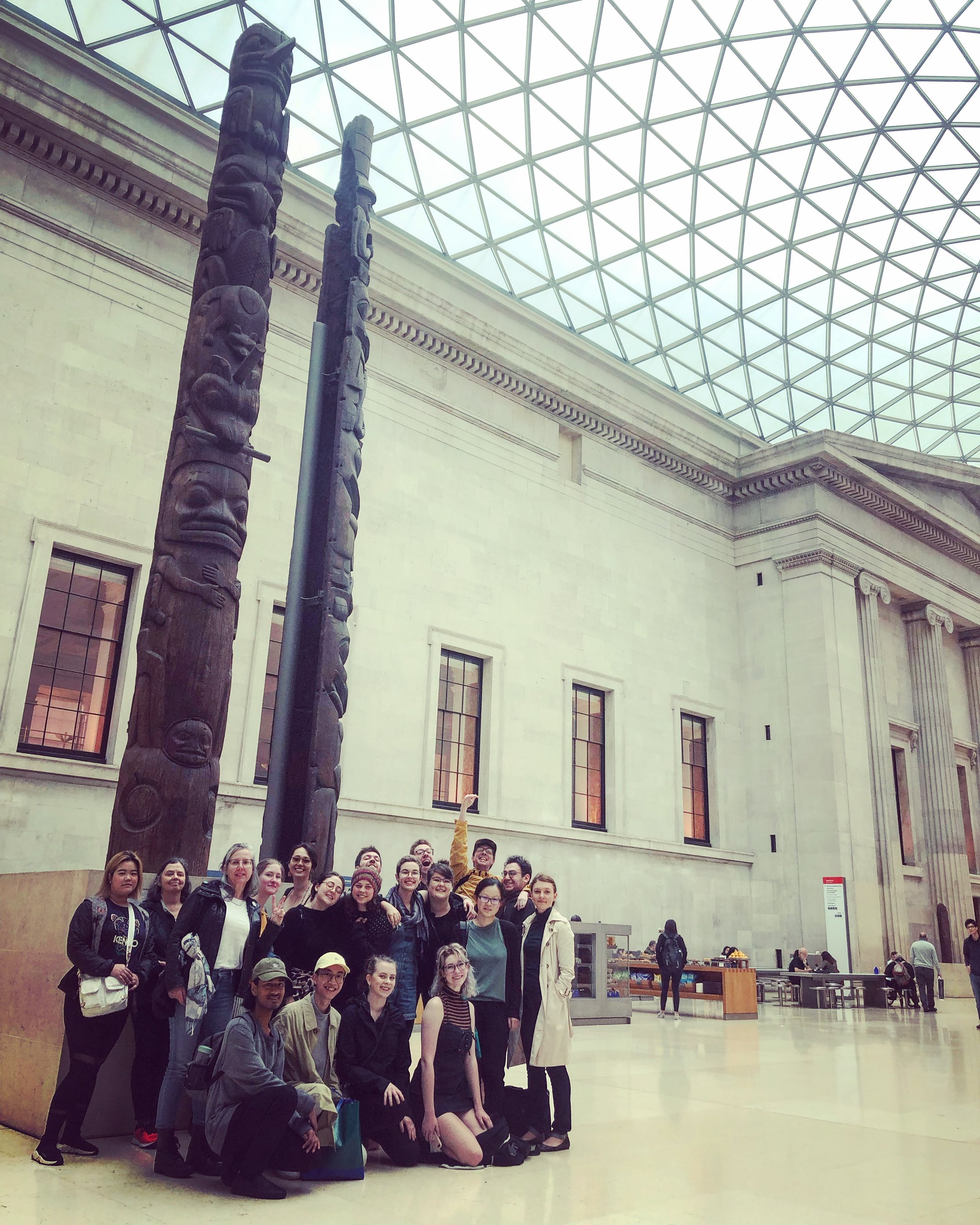 Our group visiting the British Museum— we were happy to pose with First Nations totem poles from British Columbia.