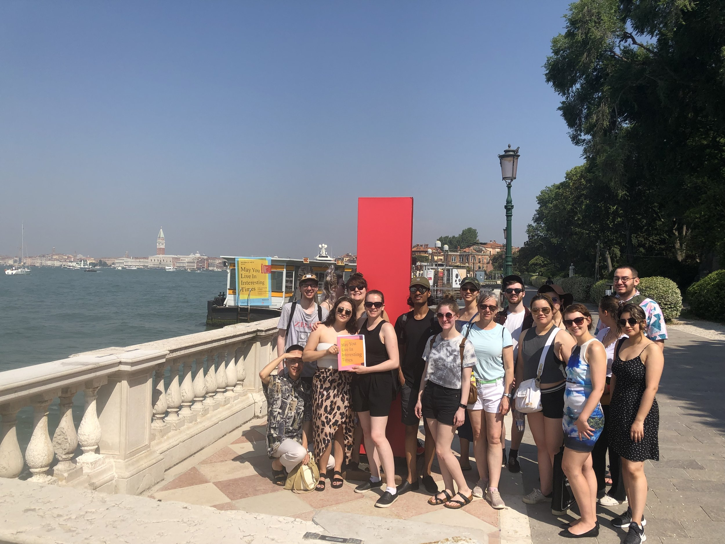 The group posing outside the Venice Biennale Giardini grounds (Allison is at center in the photo).