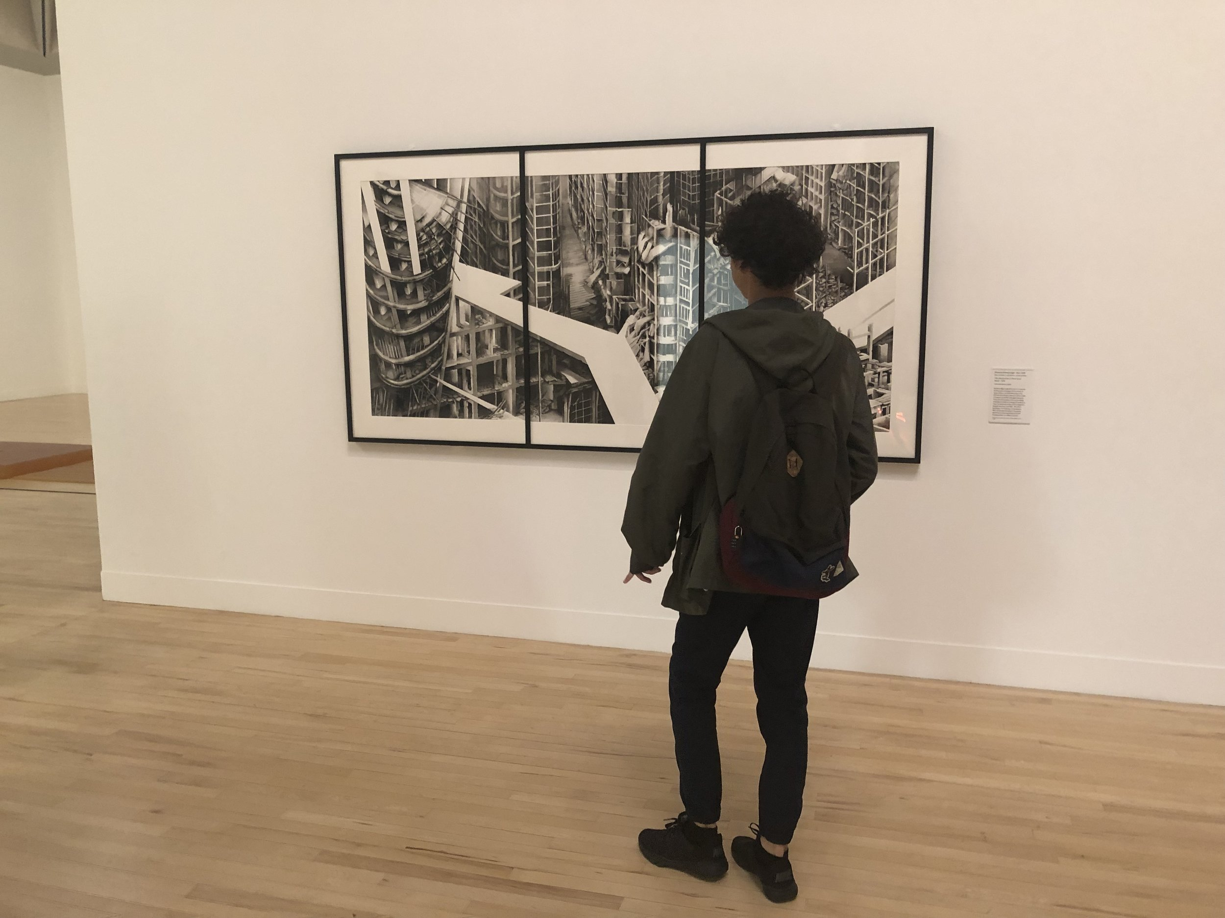 James seeing one of his assigned art works, Deanna Petherbridge's ink painting The Destruction of the City of Homs (2016), at the Tate Britain.