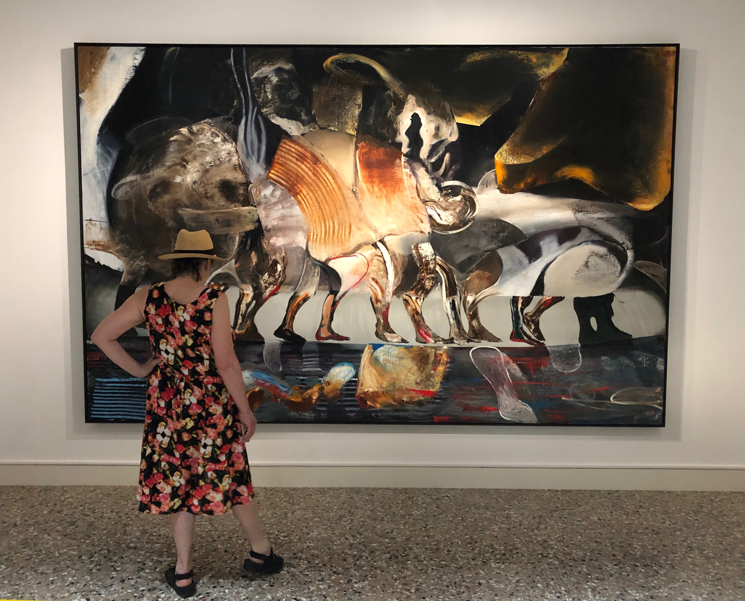 Elizabeth, at Pallazo Cini in Venice, taking in the exquisite painting  Raft  (2019) by contemporary artist  Adrian Ghenie .