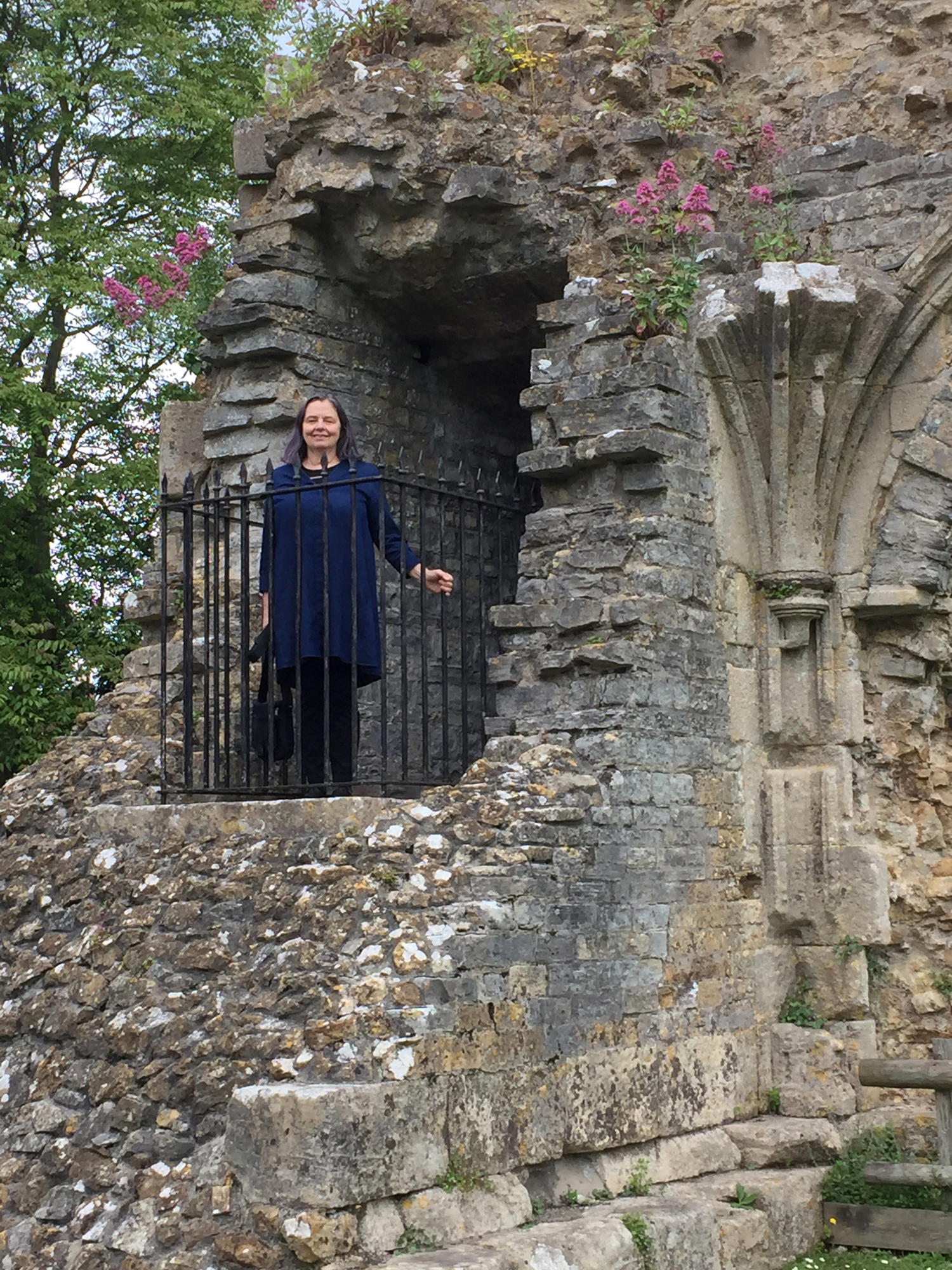 Meet field school co-leader Elizabeth, seen here in the remains of the southwest corner of the Abbot's Great Hall at the Glastonbury Abbey