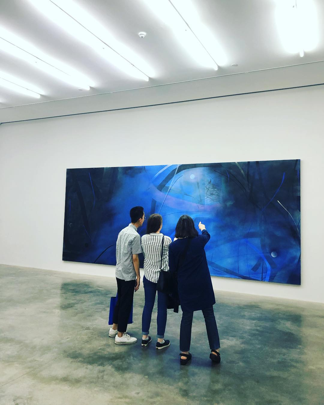 Elizabeth (right) with Ronald and Alison at White Cube art gallery in London viewing work by Zhou Li.
