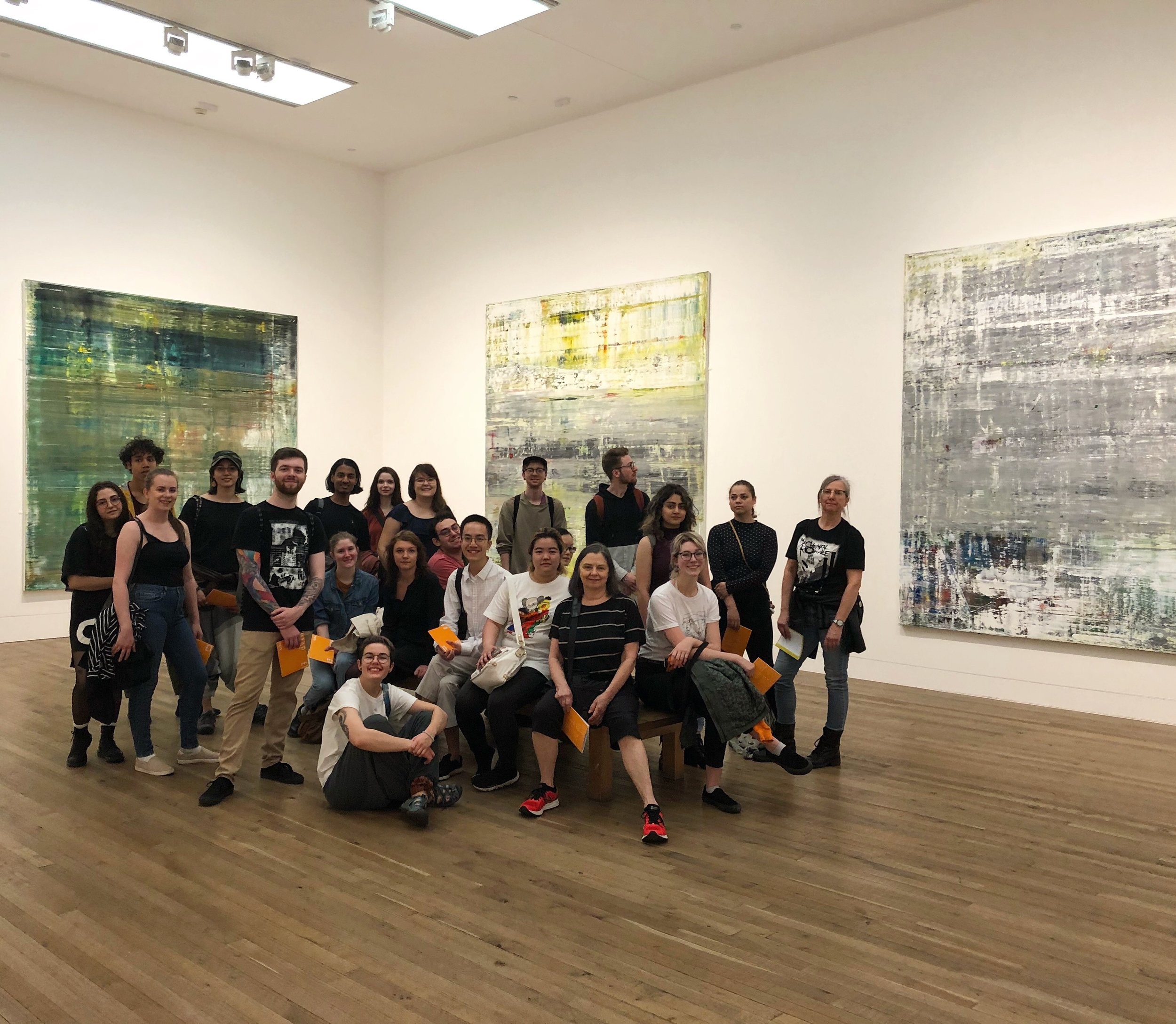 Elizabeth, fifth from right, posing with the group in the Gerhard Richter room at the Tate Modern