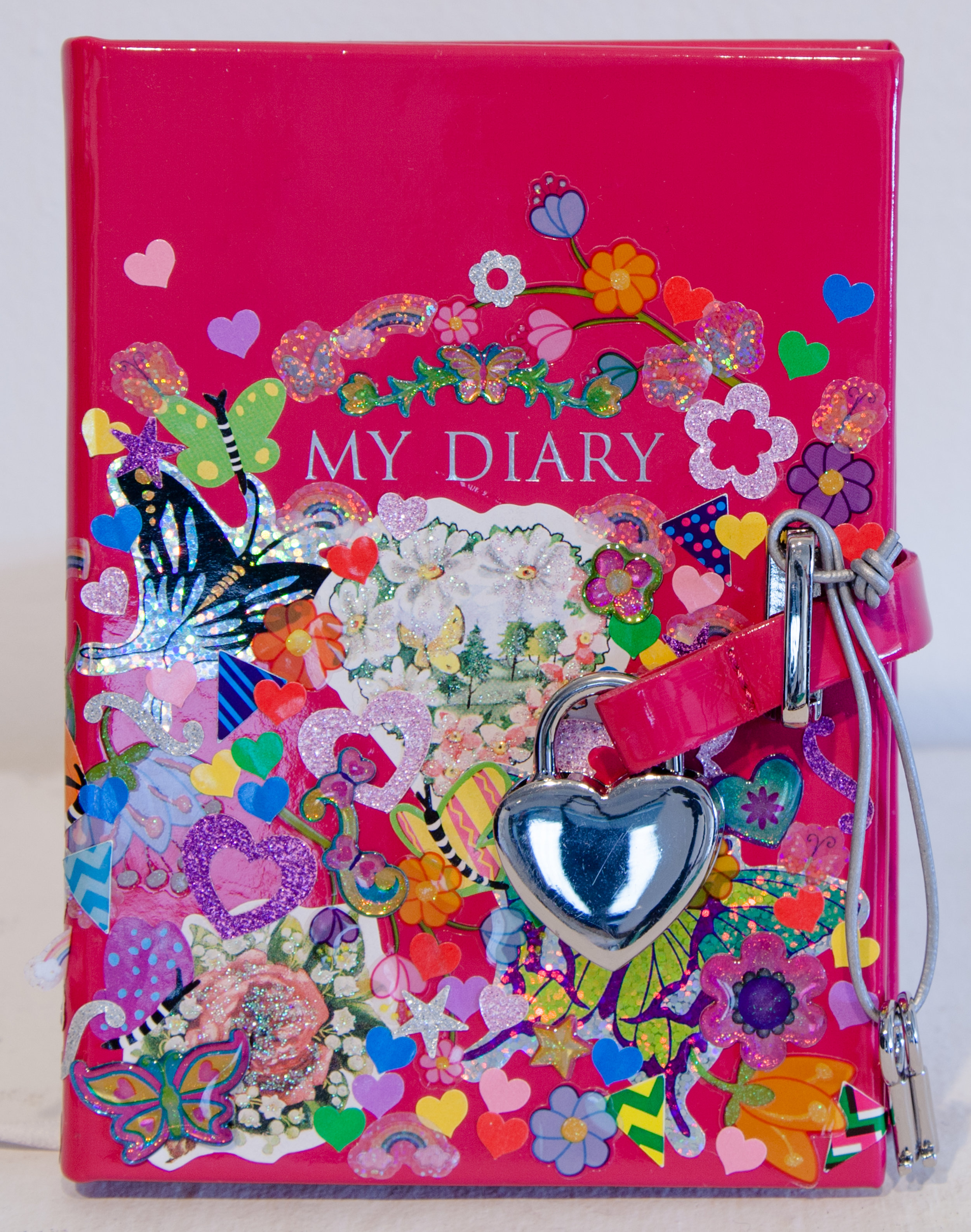 """Felia (Diary, Front) ,  found patent leather pink diary, and sticker collage, 4"""" x 6"""" x 1"""", 2016"""