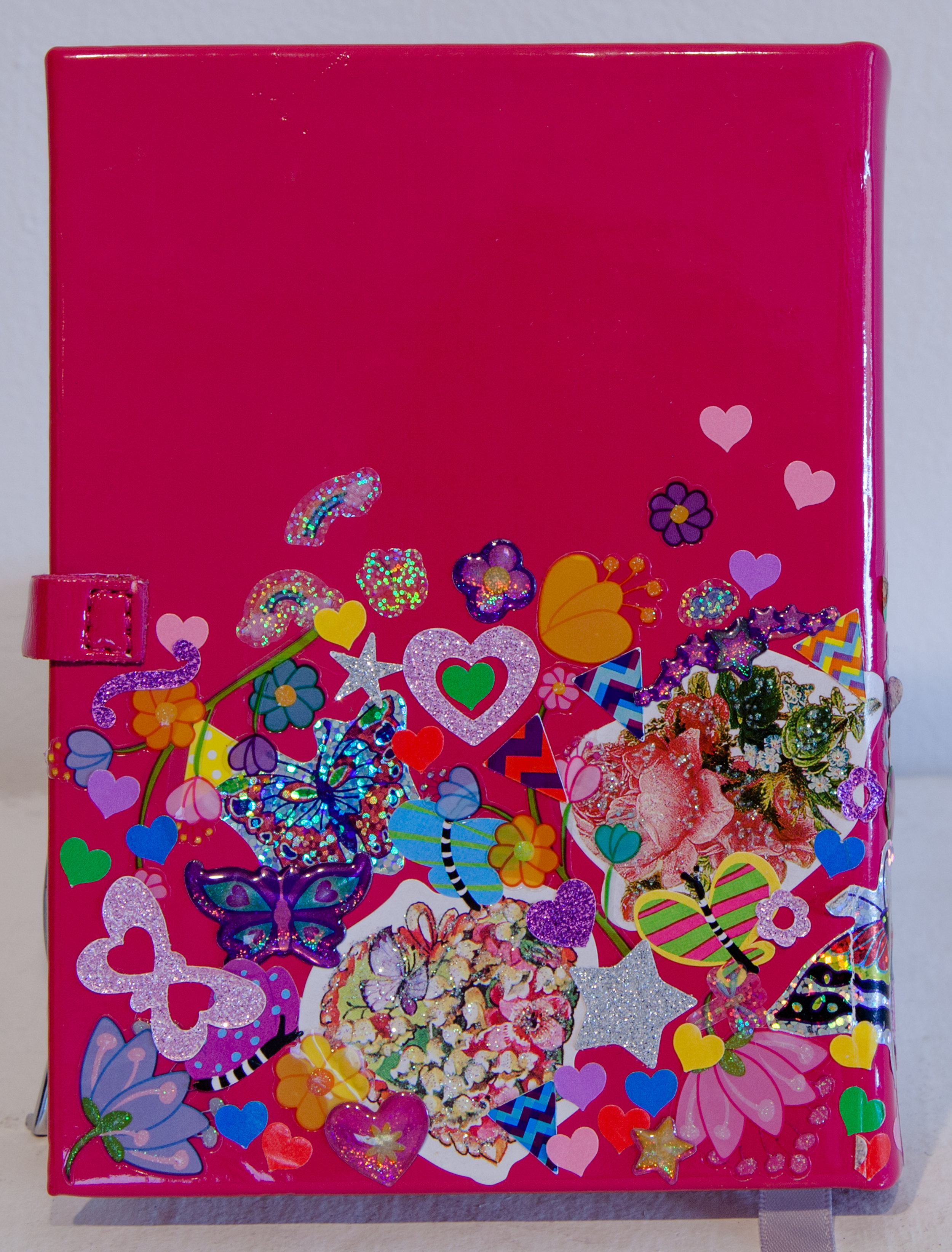 """Felia (Diary, Back) ,  found patent leather pink diary, and sticker collage, 4"""" x 6"""" x 1"""", 2016"""