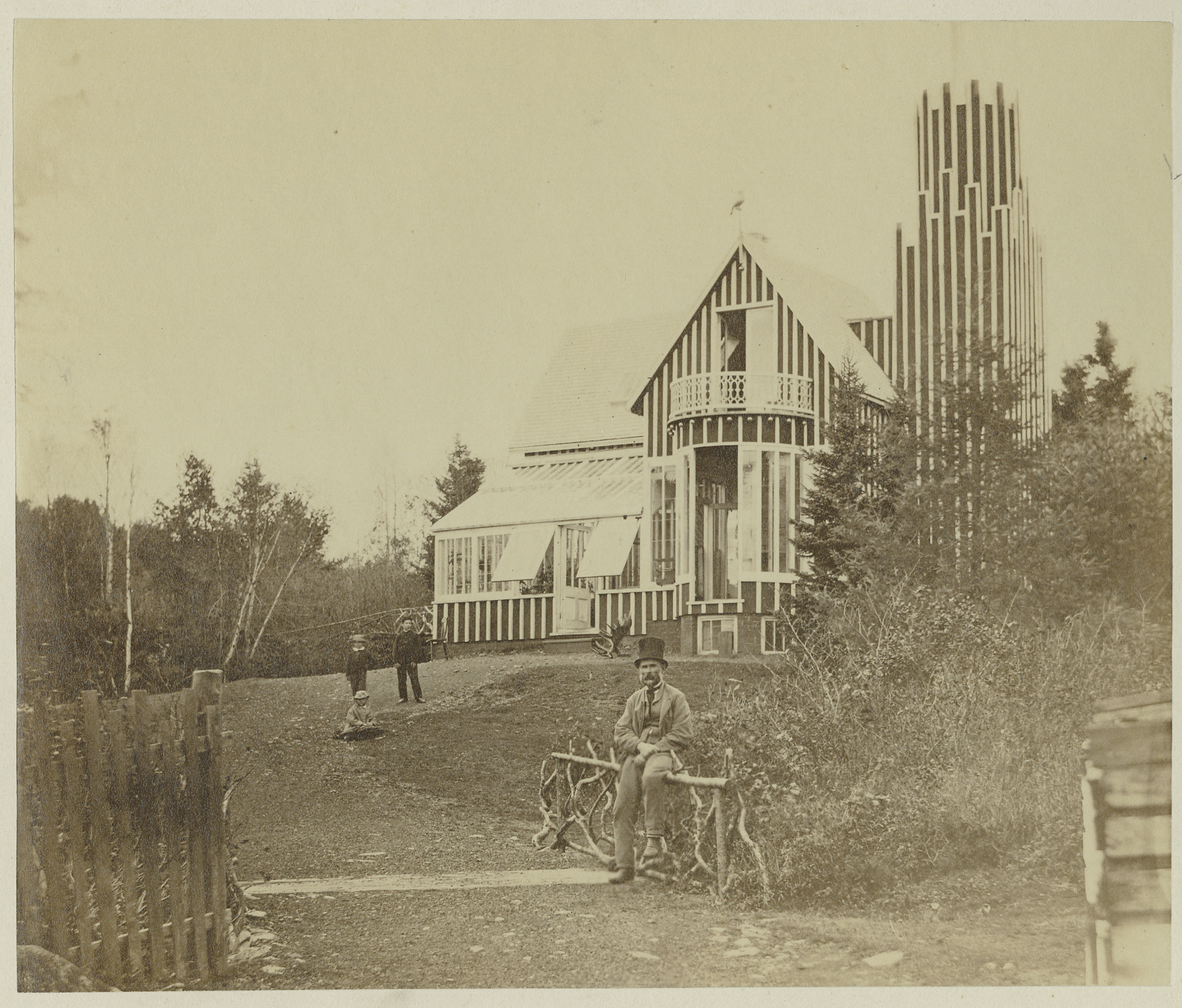 The Glass House  , The only photograph known to exist of Downs' Zoological Gardens. The proprietor himself perches in front of the Glass House (the zoo's aviary) in the 1860's.  (Presented with permission from the Nova Scotia Provincial Archives)