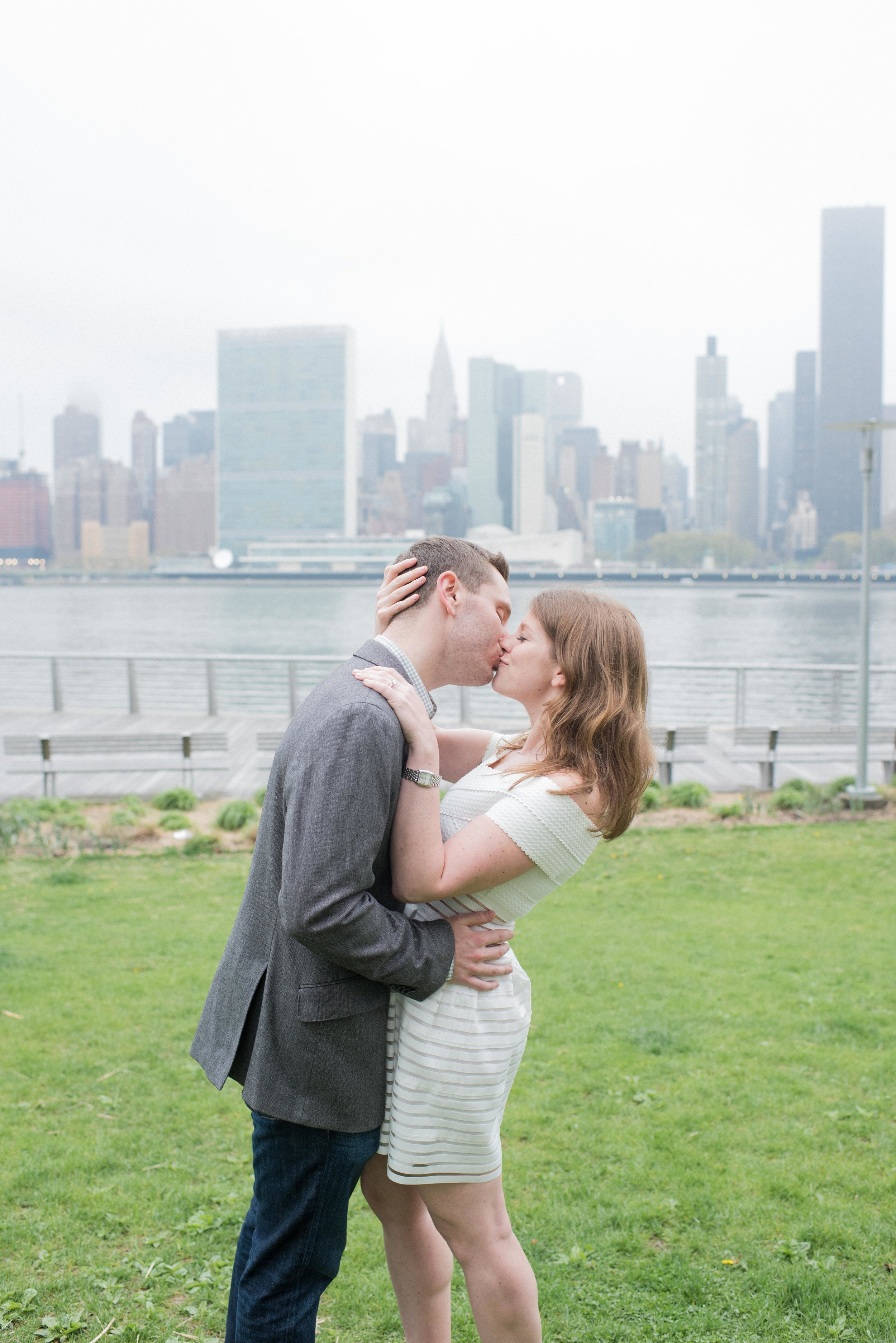 engaged couple in front of manhattan skyline, engaged couple in east river, couple, manhattan skyline, long island city engagement