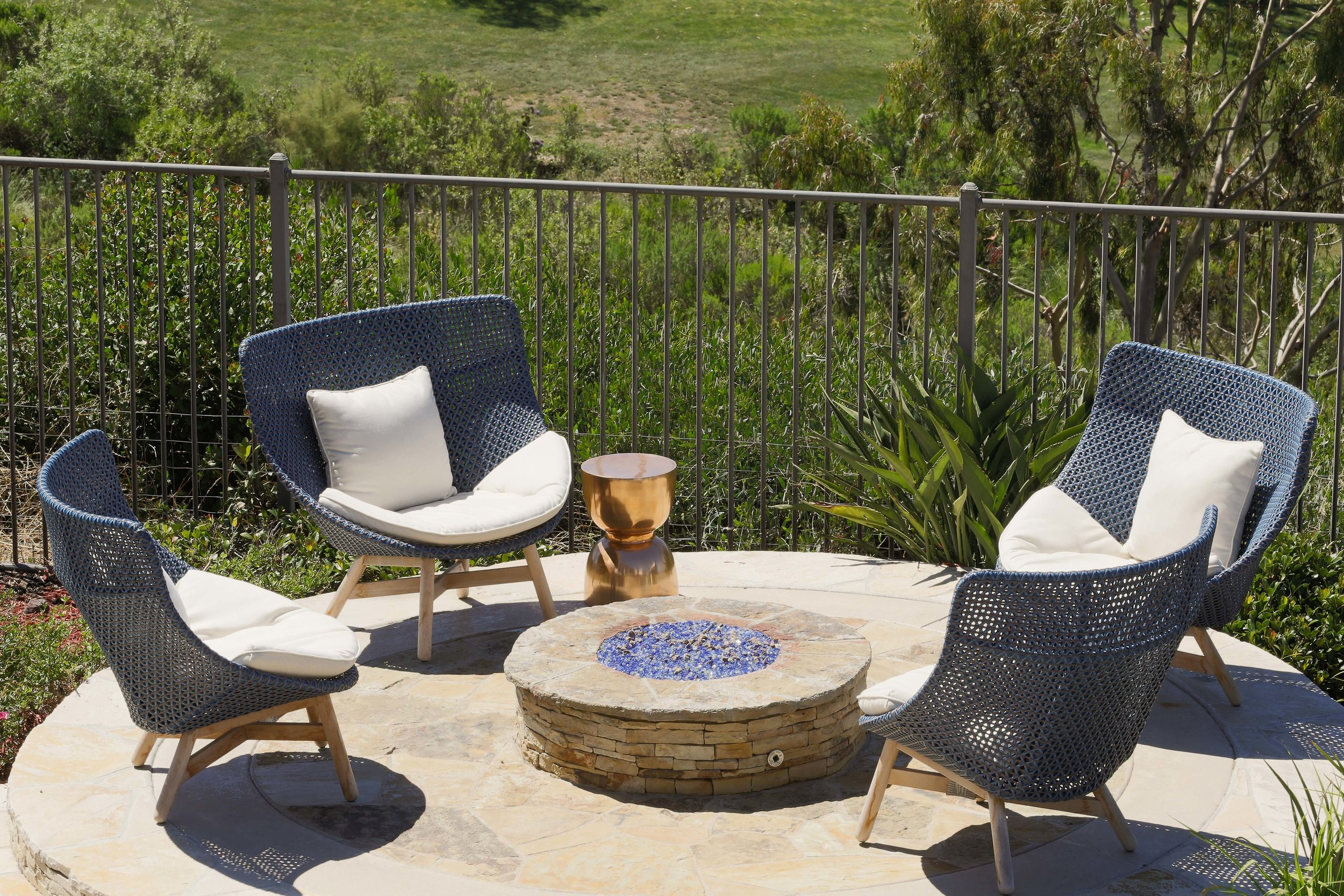 The large scale of these Dedon chairs worked perfectly in this firepit area.