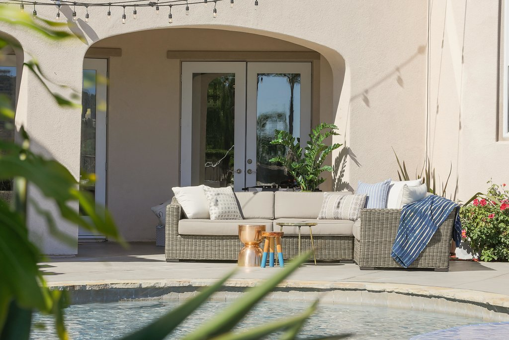 The Hibners practically live outside during the summertime, so when it came to furniture selection, it was all about bringing comfort and livability outdoors.