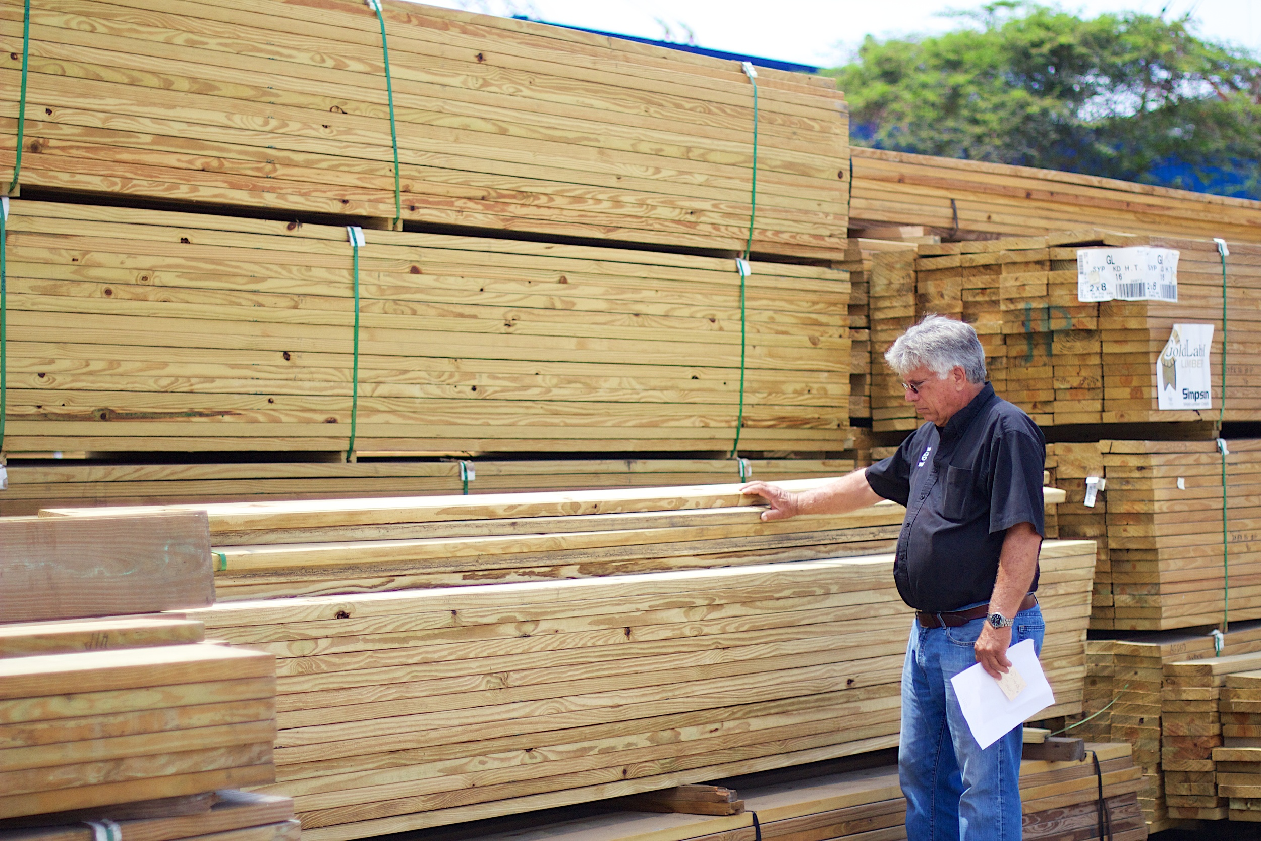 Tom Brunt, CEO, inspects a recent shipment of lumber.