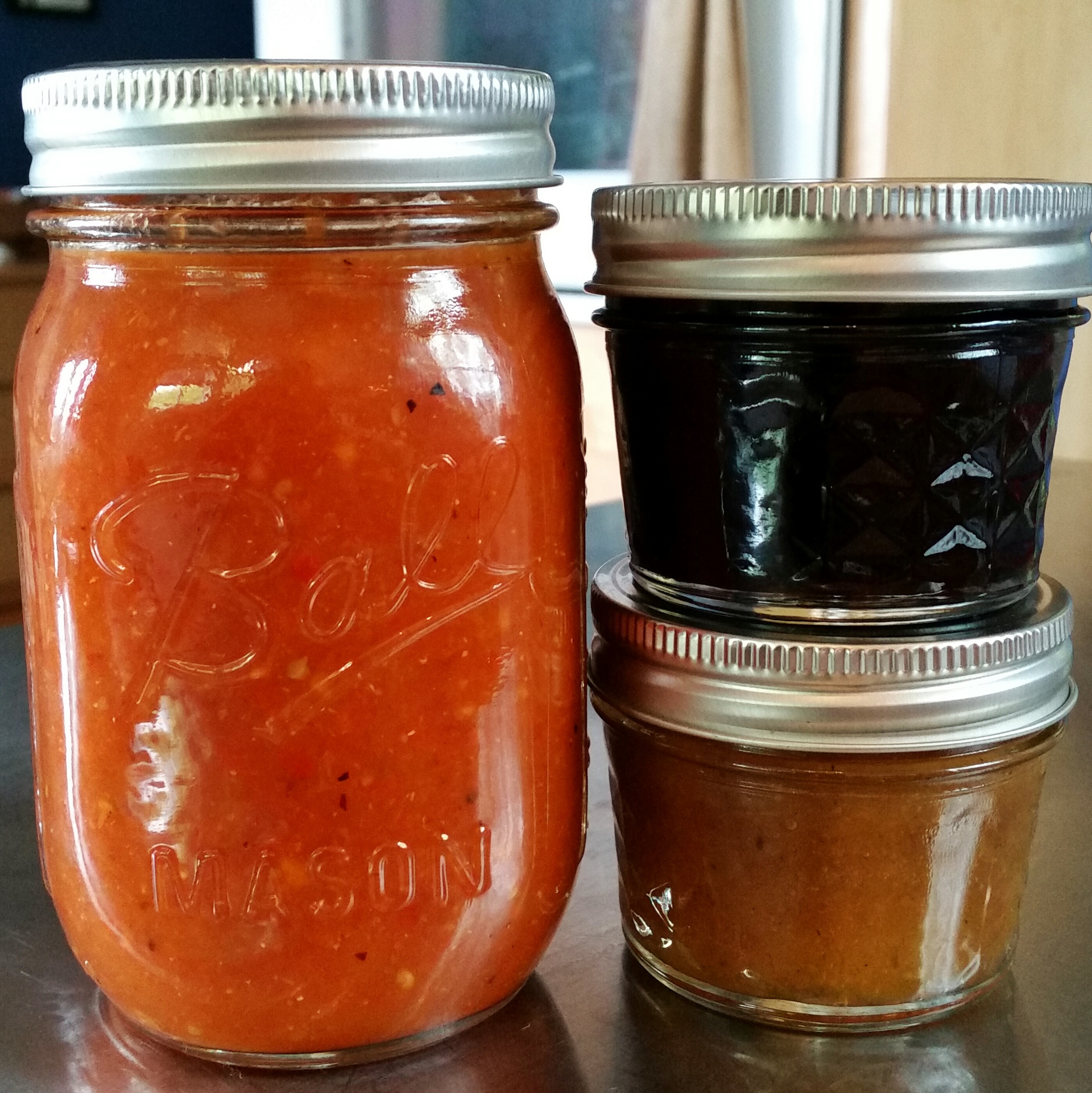 Left going clockwise:  Roasted five-chile salsa,Blueberry Chamomile Lemon Compote,Honey-sweetened spiced peach butter with bourbon.  Recipes for these goodies coming soon!