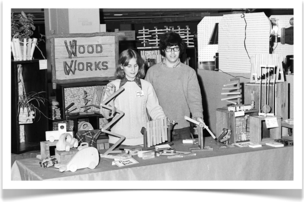 Showing the toys at a Hartford Civic Center craft fair (c 1975)