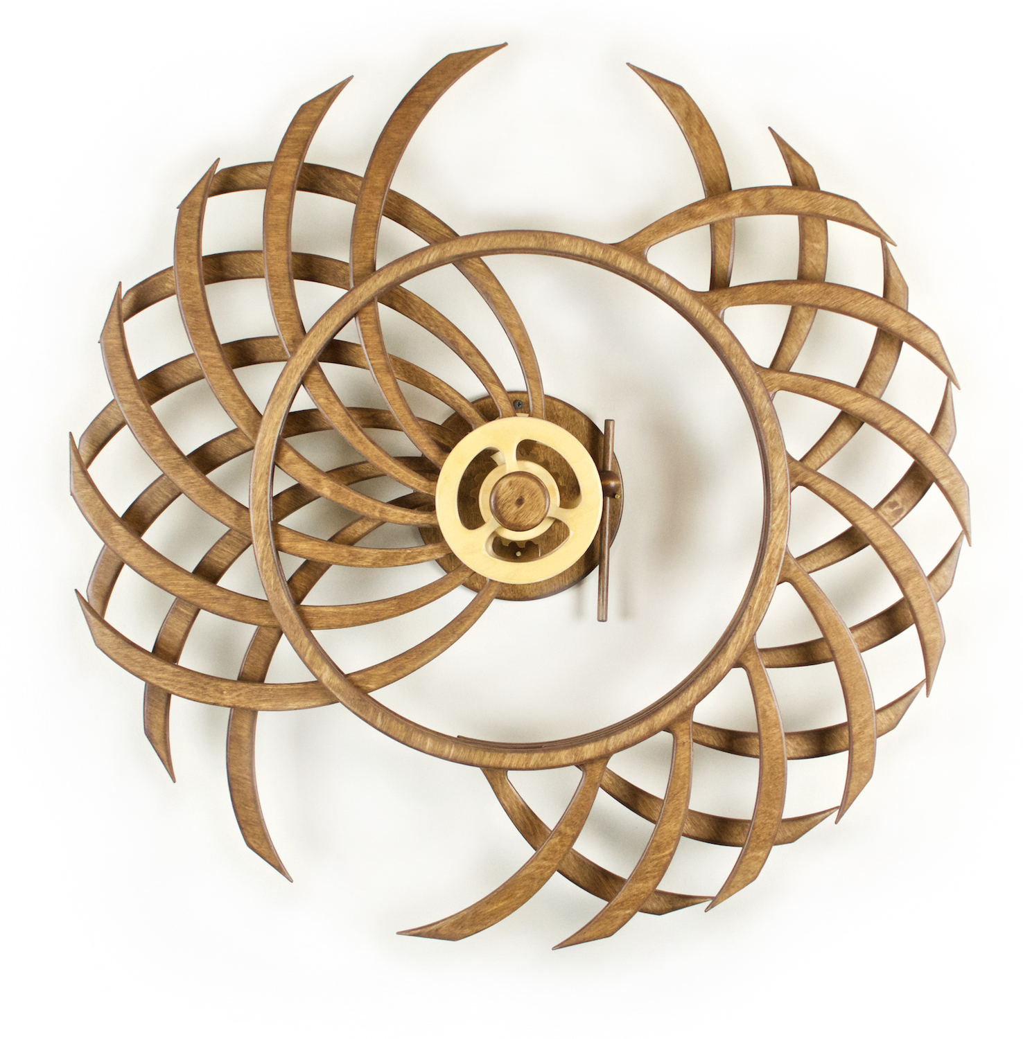 Spring-driven, Kinetic Wooden Wall sculpture by David C. Roy of WoodThatWorks.com. Duality runs for 8 hours per winding an is in an edition of 95. copyright 2017